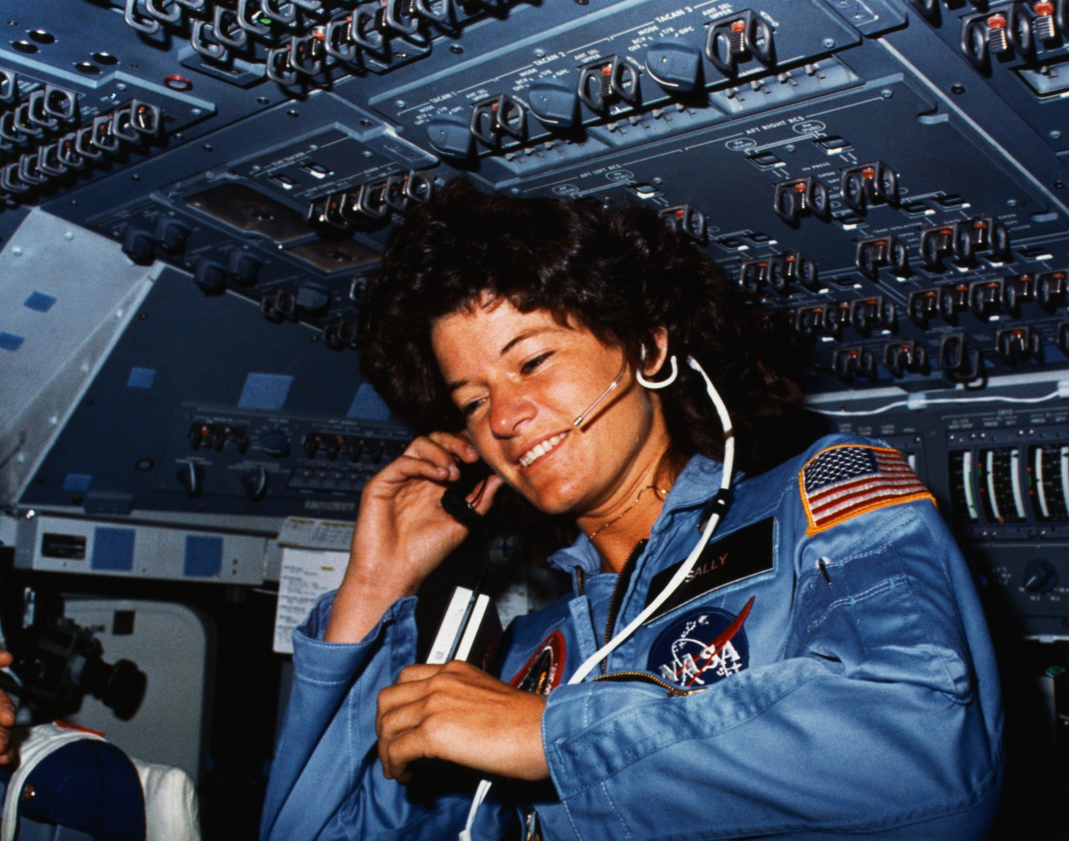 Johnson Space Center, Houston, Texas: Onboard Scene-Astronaut Sally K. Ride, STS-7 mission specialist, communicates with ground controllers from the flight deck of the Earth-orbiting Space Shuttle Challenger. (NASA via Getty Images)