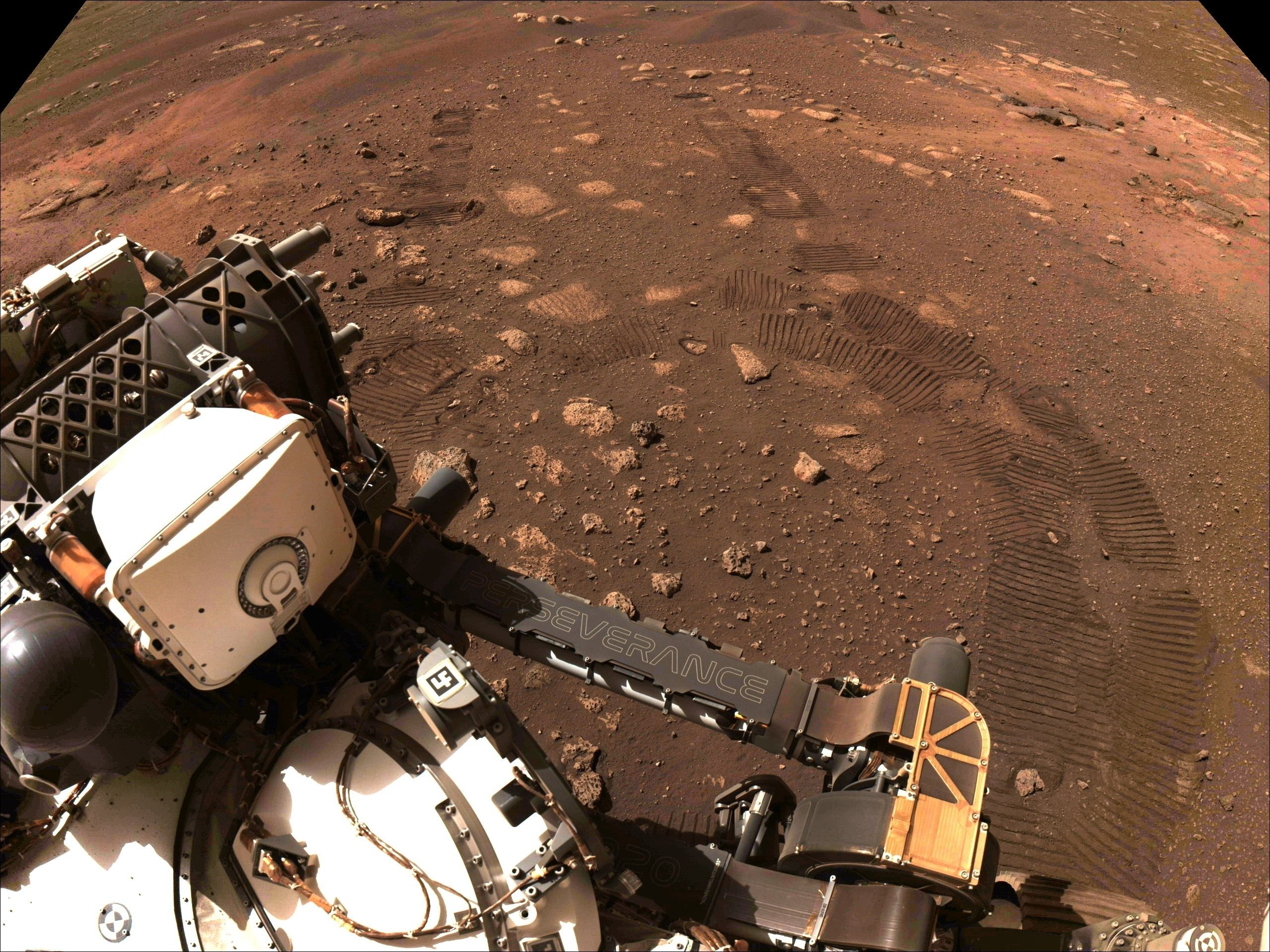This photo made available by NASA was taken during the first drive of the Perseverance rover on Mars on Thursday, March 4, 2021. Perseverance landed on Feb. 18, 2021. (NASA/JPL-Caltech via AP)