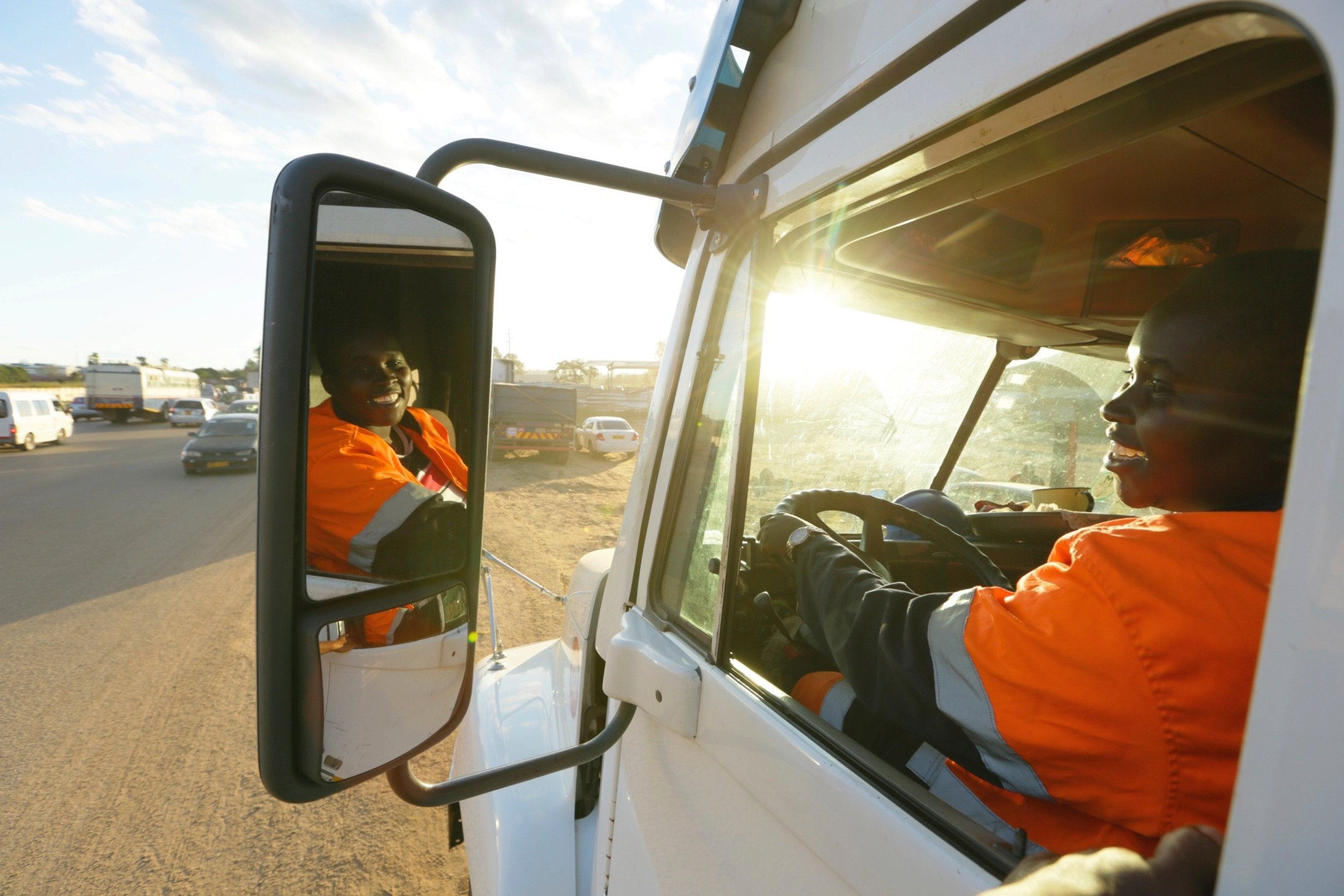 Molly Manatse a female truck driver is seen on the road in Harare, Zimbabwe, March 6, 2021. (AP Photo)