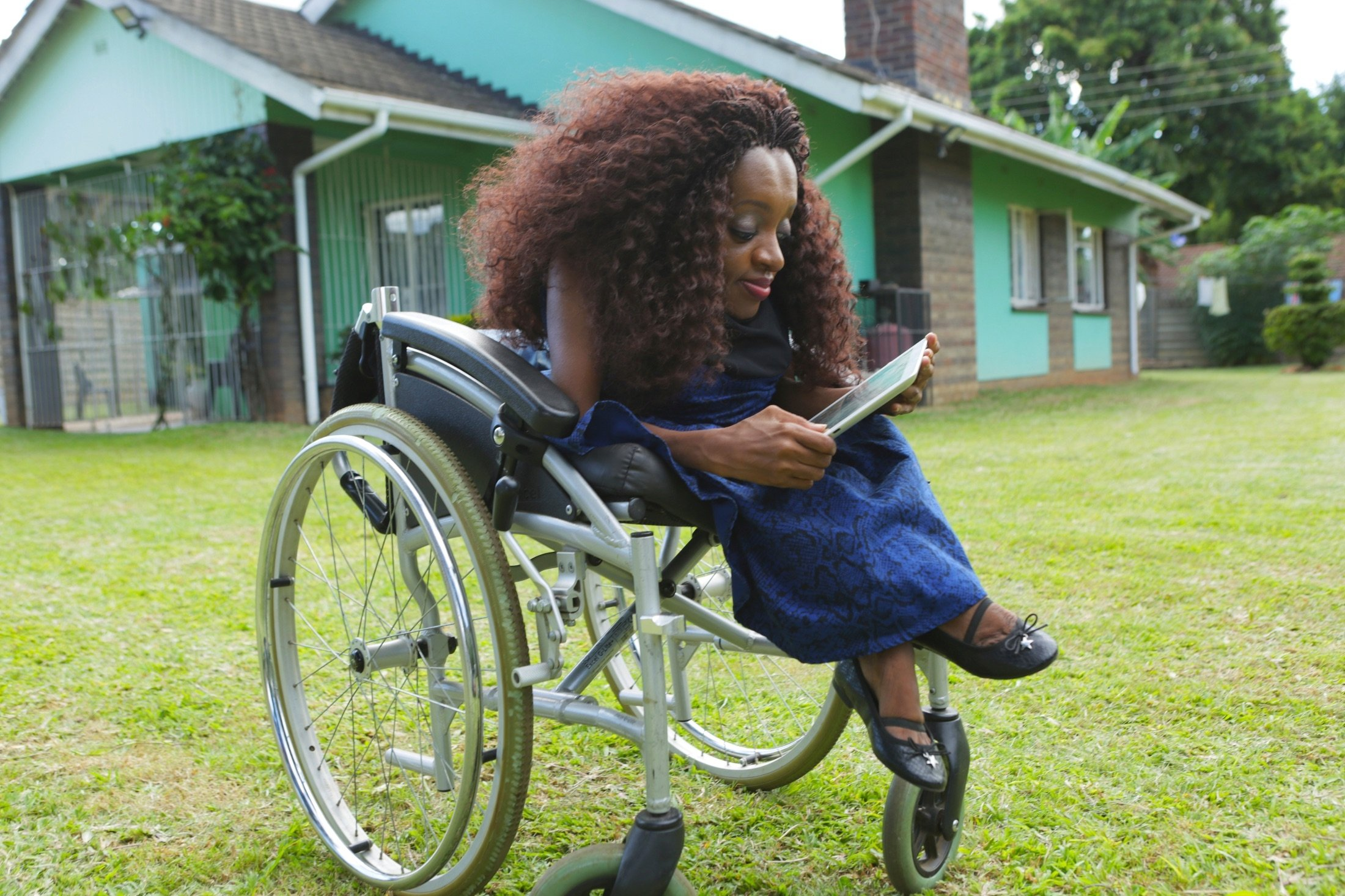 Florence Mudzingwa, a digital marketer and life coach, works from her wheelchair at her family home in  Harare, Zimbabwe, March 6, 2021. (AP Photo)