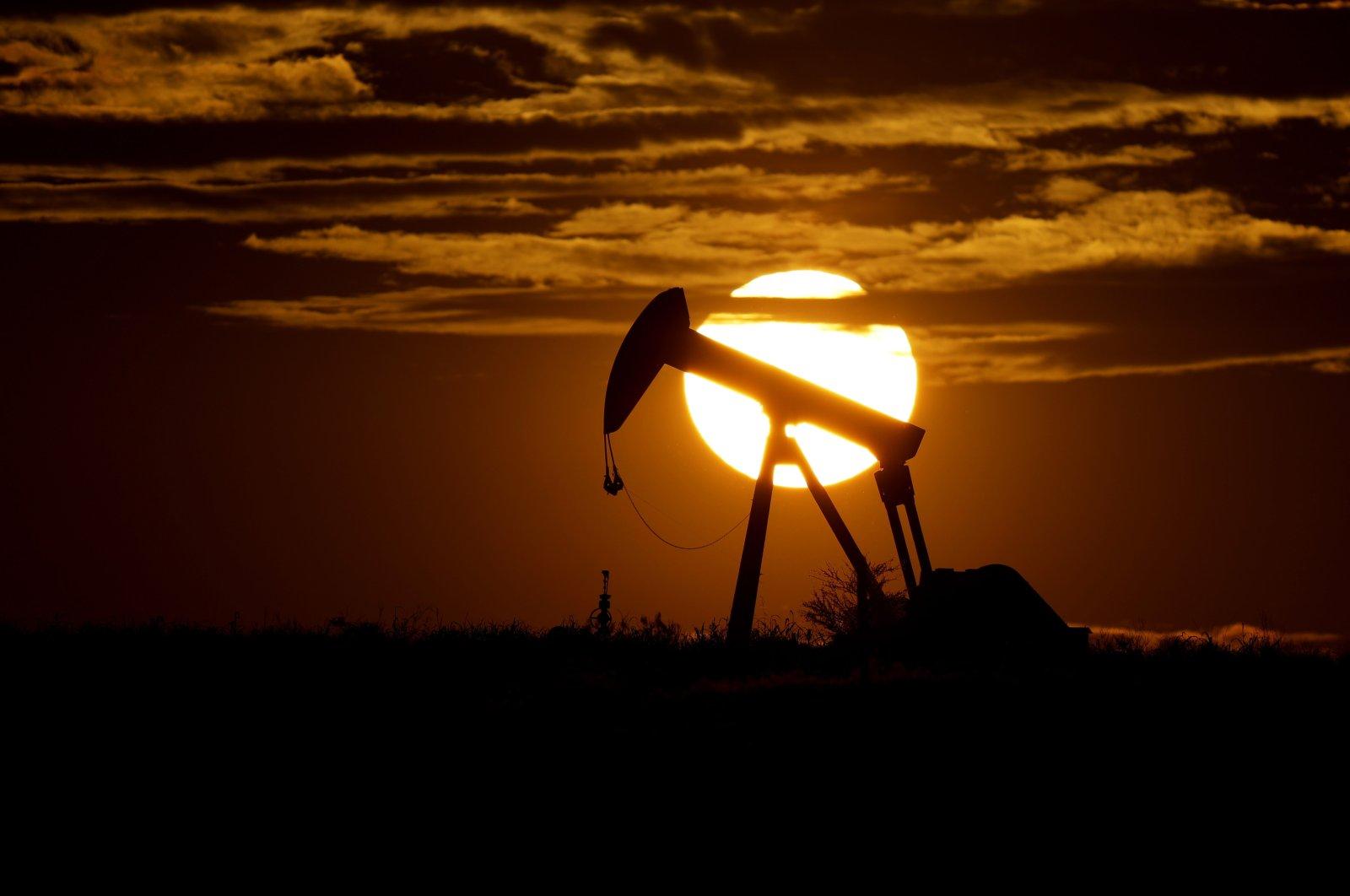 The sun sets behind an idle pump jack near Karnes City, U.S, April 8, 2020. (AP Photo)
