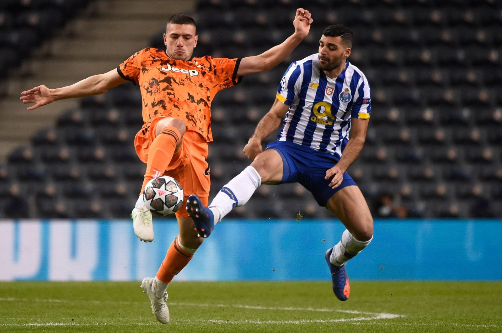 Juventus' Turkish defender Merih Demiral (L) vies with FC Porto's Iranian forward Mehdi Taremi during the UEFA Champions League round of 16 first leg match at the Dragao stadium in Porto, Feb. 17, 2021. (AFP Photo)