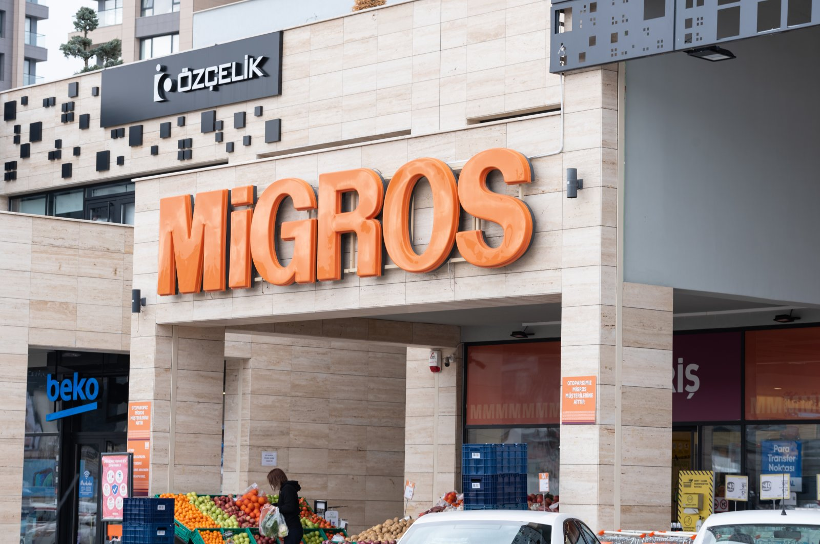The logo of Turkish retail giant Migros seen at the entrance of one of its stores in capital Ankara, Turkey, Dec. 20, 2020.