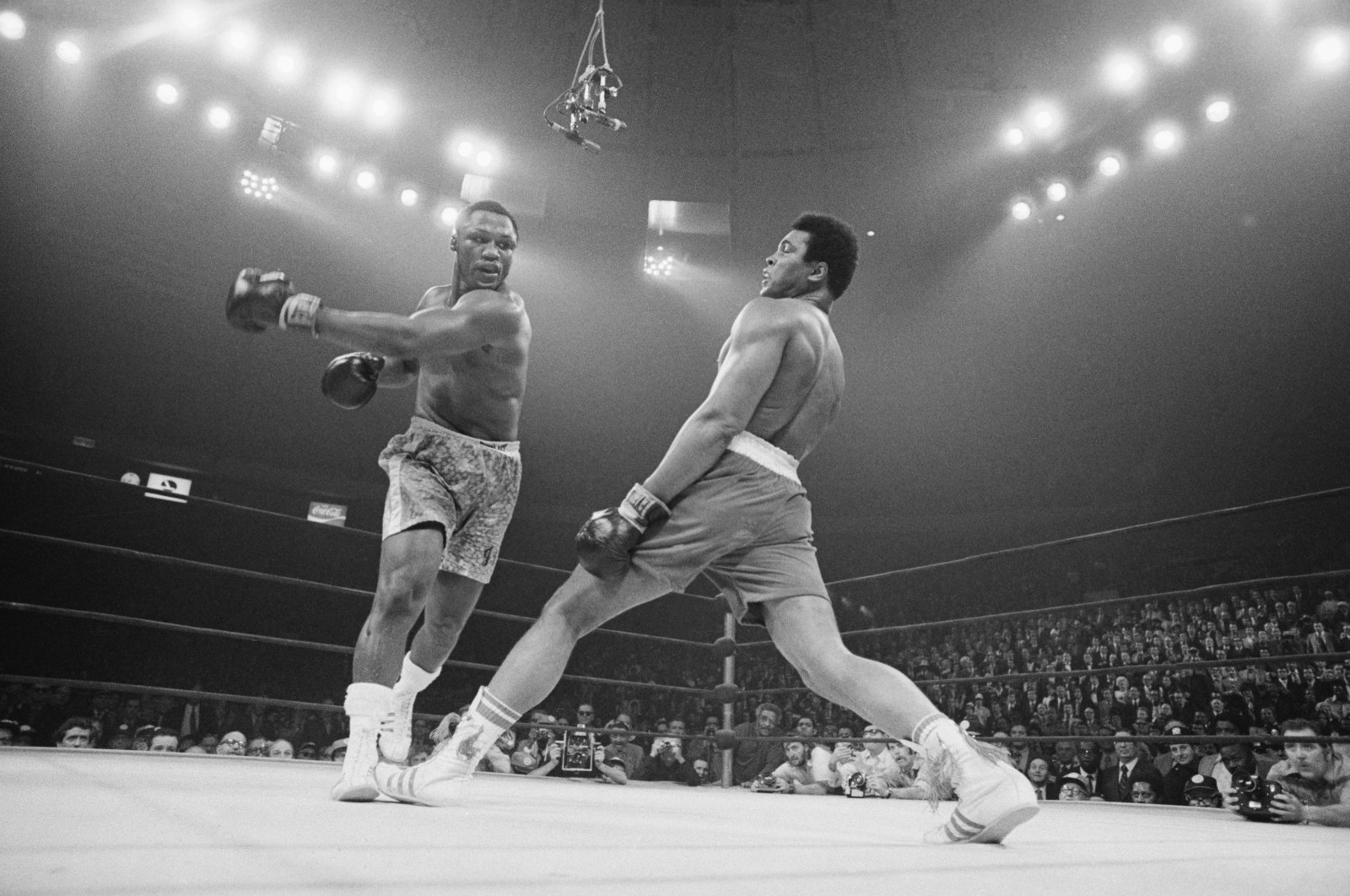Boxer Muhammad Ali (R) steps away from a punch thrown by boxer Joe Frazier during their heavyweight title fight at Madison Square Garden, New York, U.S., March 8, 1971. (Getty Images Photo)