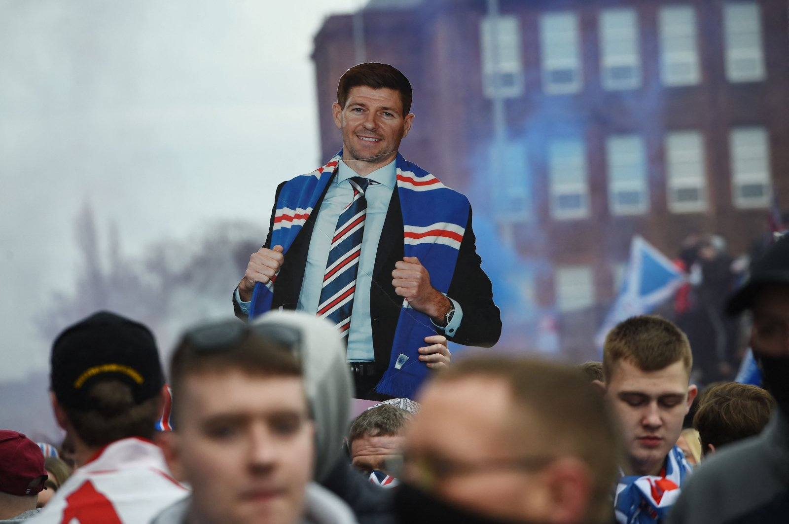Rangers fans with a cut-out of English manager Steven Gerrard celebrate outside Ibrox Stadium, home of Rangers Football Club, in Glasgow, Scotland, March 7, 2021. (AFP Photo)