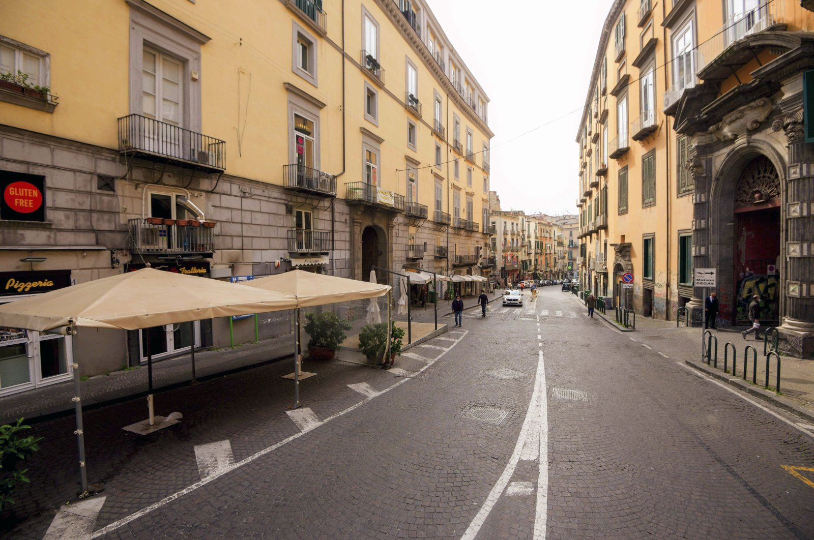 A view of an almost deserted Piazza del Gesu', in downtown Naples, Italy, Monday, March 8, 2021 following restriction measures to curb the spread of COVID-19. (LaPresse via AP)