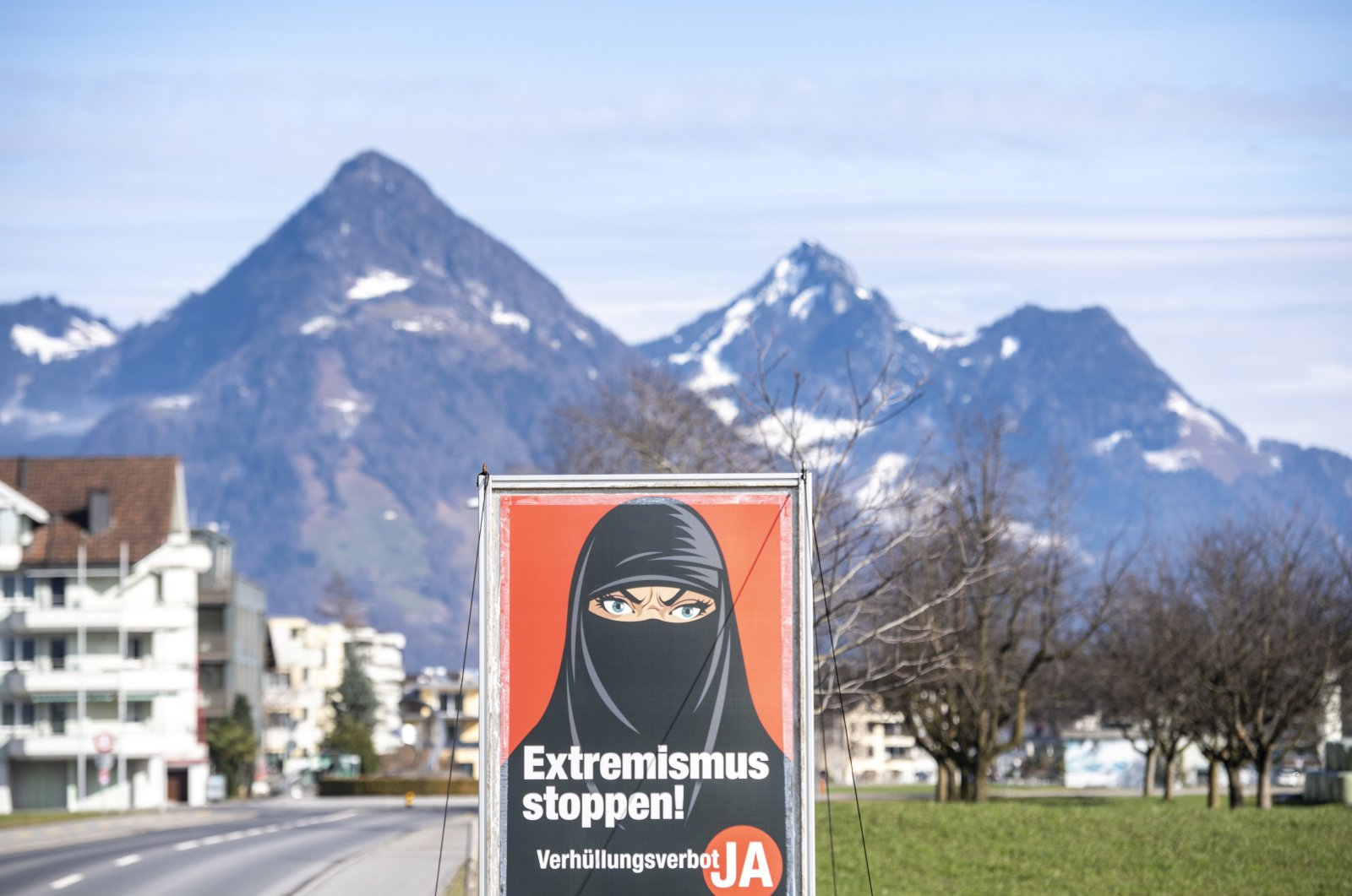 """A poster of the initiative """"Yes to the burqa-ban"""" is seen in Oberdorf, in the canton of Nidwalden, Switzerland, Feb. 16, 2021. (EPA Photo)"""