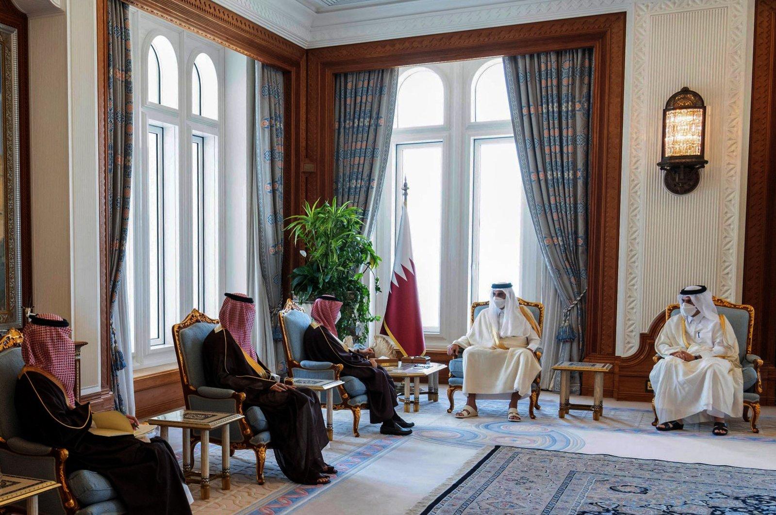 This handout picture released by the Qatar Amiri Diwan on March 8, 2021, shows the emir of Qatar, Sheikh Tamim bin Hamad Al Thani (2nd R), meeting with Saudi Arabia's Foreign Minister Prince Faisal bin Farhan Al Saud (3rd L) in the Qatari capital Doha. (AFP Photo)