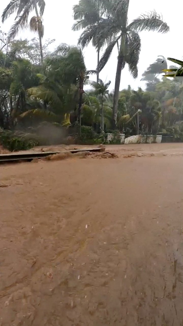 "A flooded road is seen near the breached Kaupakalua dam, in Haiku on Maui, Hawaii, U.S., March 8, 2021. (""Monkeys with Drums"" website via Reuters)"