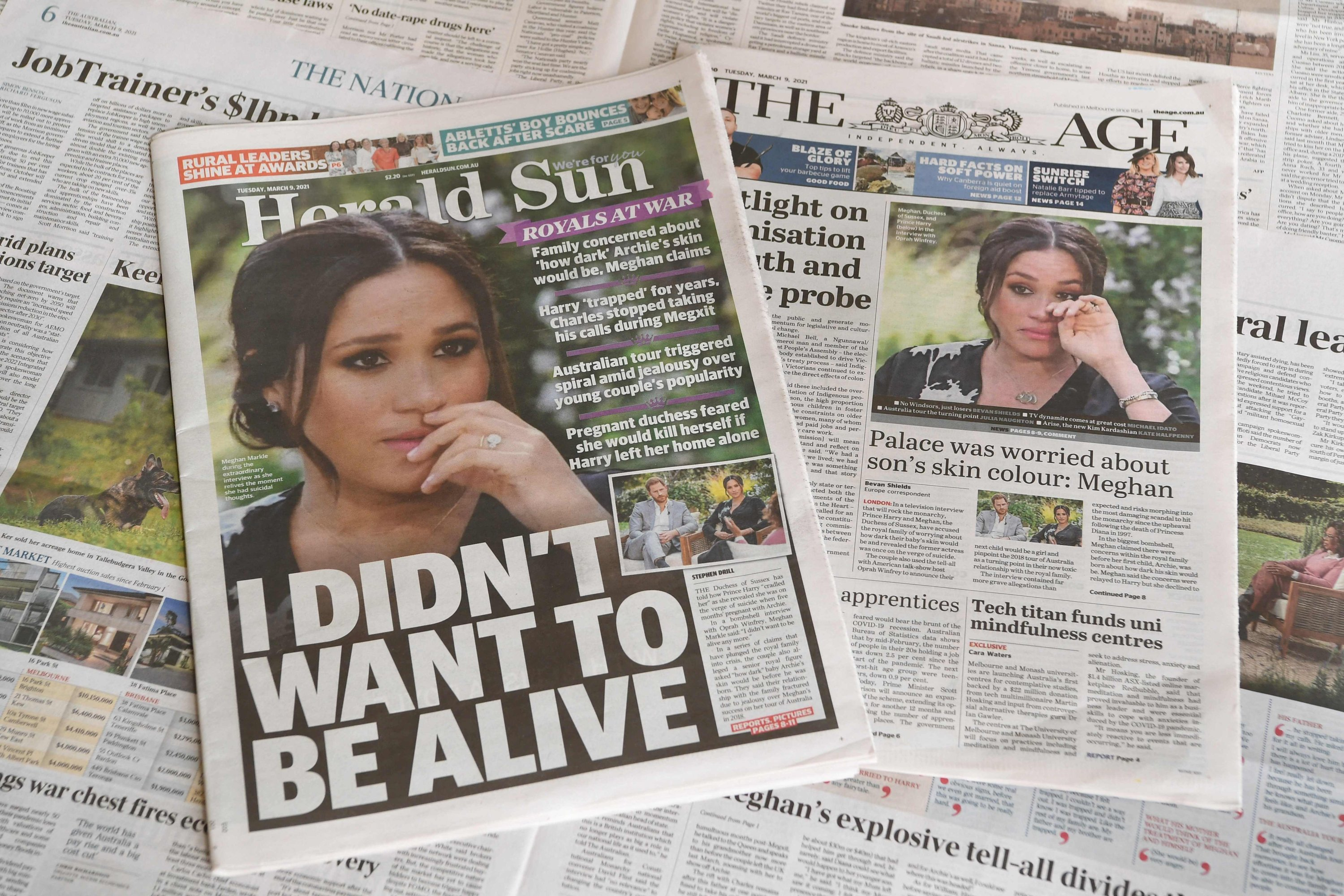Frontpage headlines reporting about the Oprah Winfrey interview with Harry and Meghan, March 9, 2021. (AFP Photo)