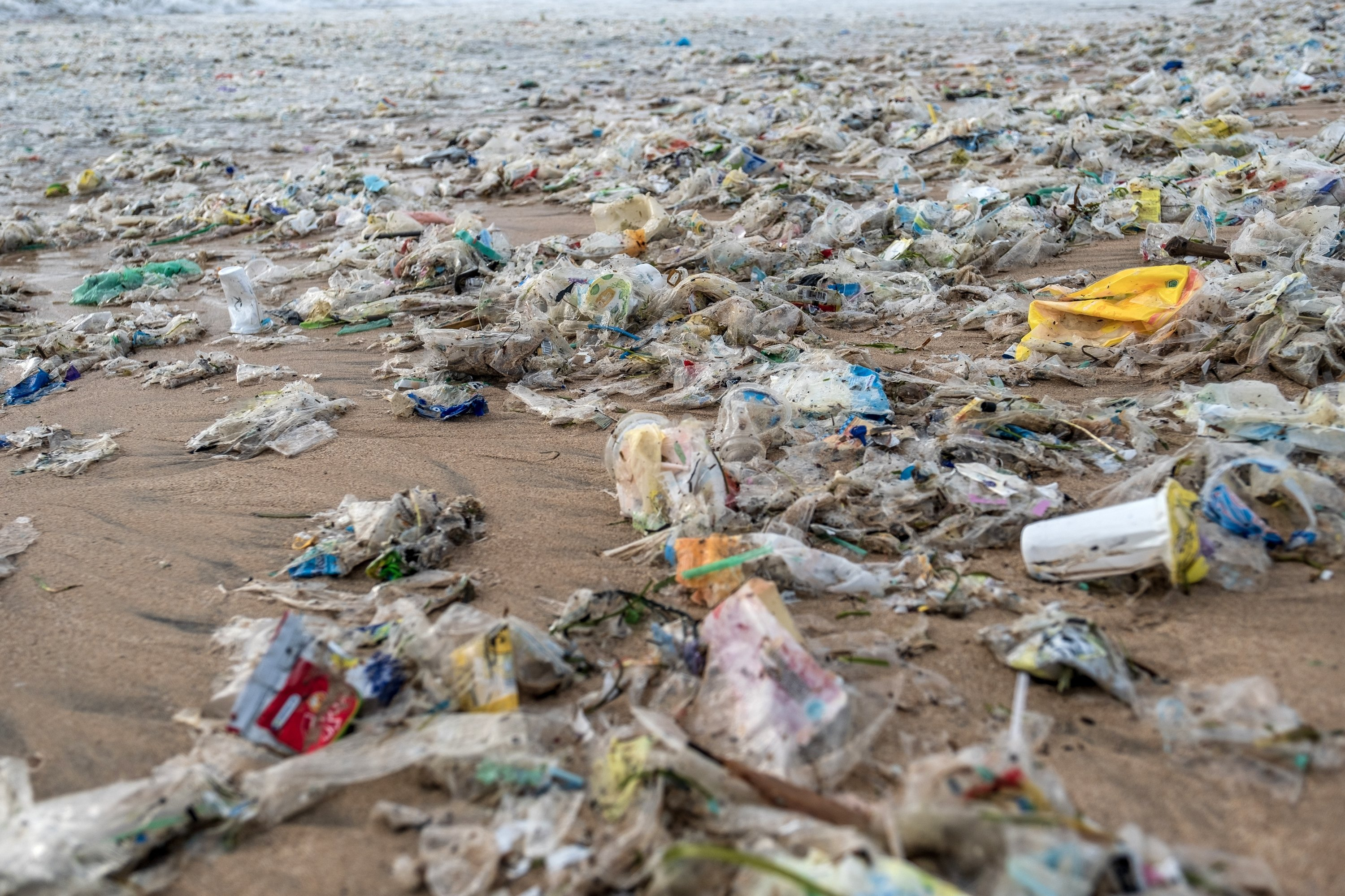 Plastic trash scattered on the beach which was brought in by the strong wave during the northwest monsoon season at Jimbaran beach, Bali, Indonesia, Jan. 27, 2021. (Photo by Getty Images)
