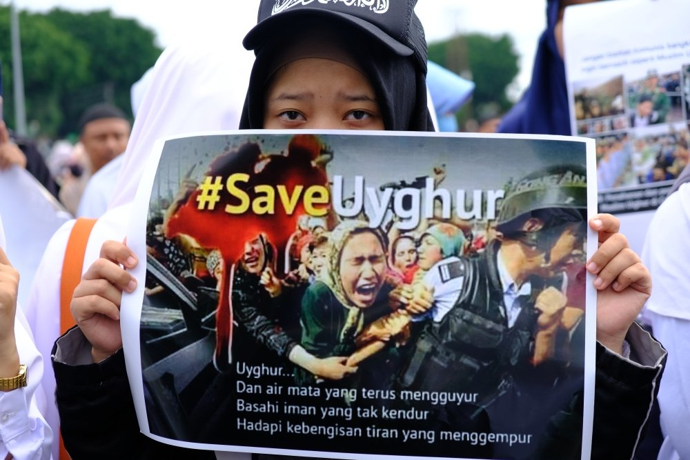 A woman takes part in aprotestagainst China's treatment of Muslim Uyghurs at the Zero Point of the city of Yogyakarta, Indonesia, Dec. 21, 2018. (Shutterstock Photo)