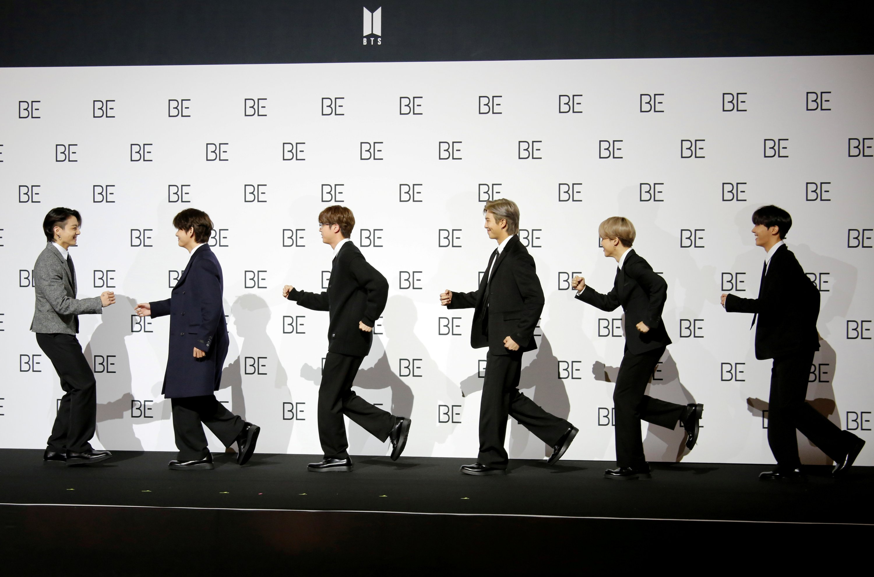 Members of K-pop boy band BTS pose for photographs during a news conference promoting their new album 'BE(Deluxe Edition)' in Seoul, South Korea, Nov. 20, 2020. (REUTERS Photo)