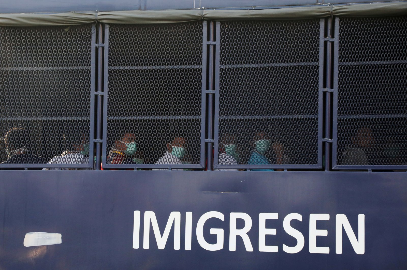 Myanmar migrants to be deported from Malaysia are seen inside an immigration truck, in Lumut, Malaysia, Feb. 23, 2021. (Reuters Photo)