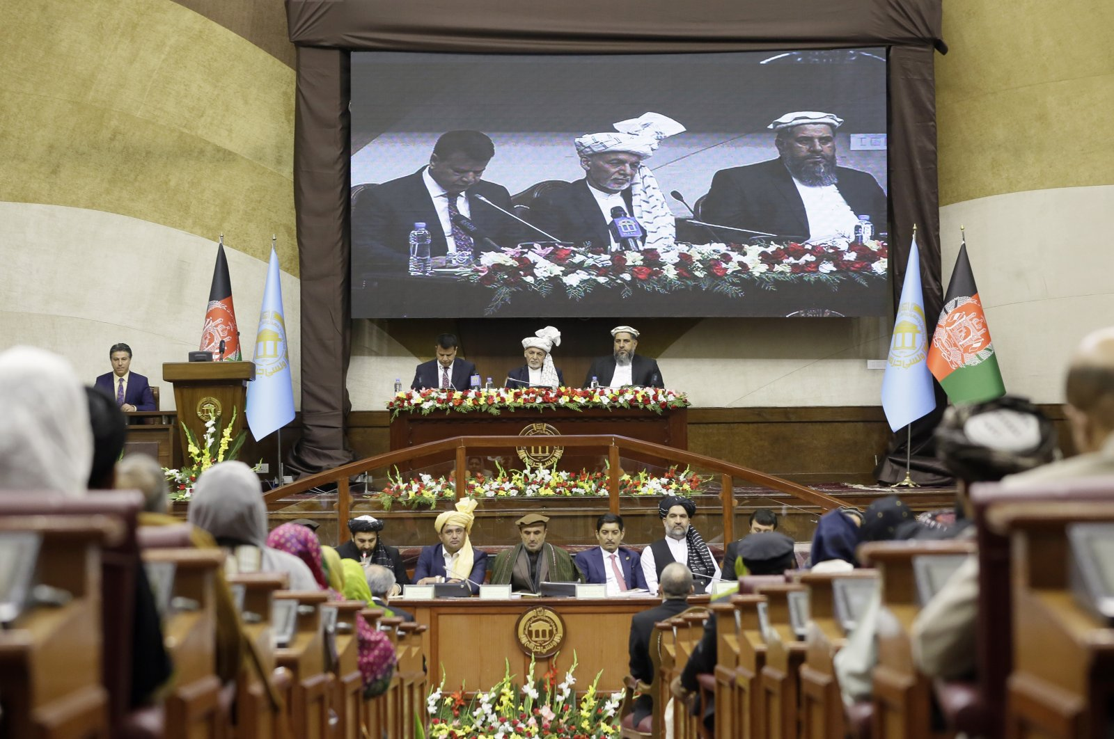 Afghan President Ashraf Ghani, center top, attends the opening ceremony of the new legislative session of the Parliament in Kabul, Afghanistan, Saturday, March 6, 2021. (AP Photo)