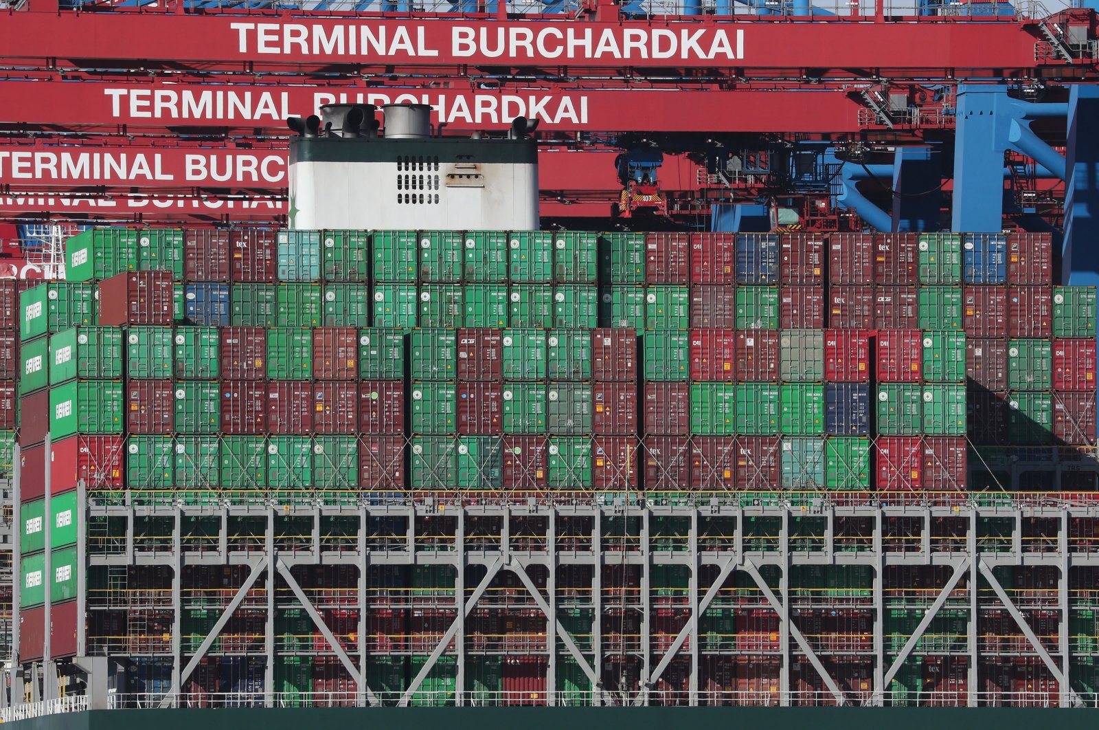Containers are stacked on a ship at the Burchardkai container terminal of port operator HHLA in Hamburg, northern Germany, Feb. 24, 2021. (EPA Photo)