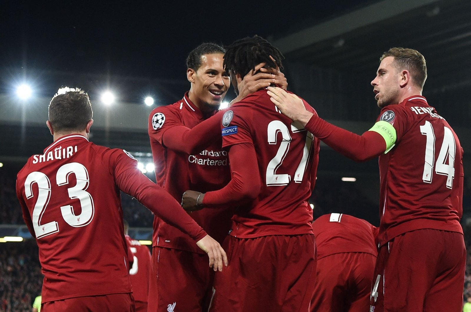 Liverpool's Belgium striker Divock Origi (2nd R) celebrates with Liverpool's Dutch defender Virgil van Dijk after scoring their fourth and winning goal during the UEFA Champions League semifinal against Barcelona at Anfield in Liverpool, northwest England, May 7, 2019. (AFP Photo)