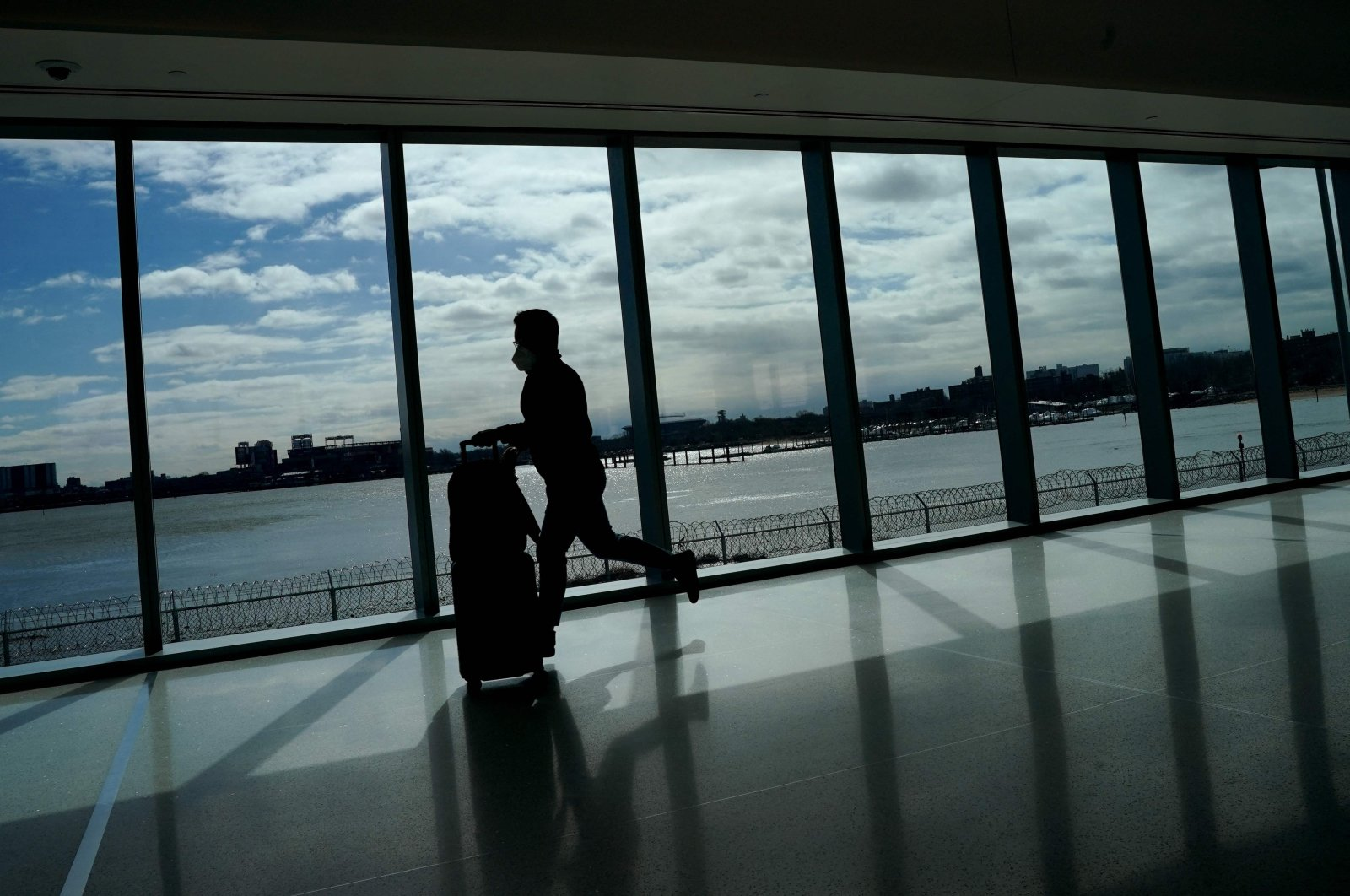 A person runs through the newly renovated Delta Terminal D at LaGuardia Airport in New York, U.S., March 6, 2021. (AFP Photo)