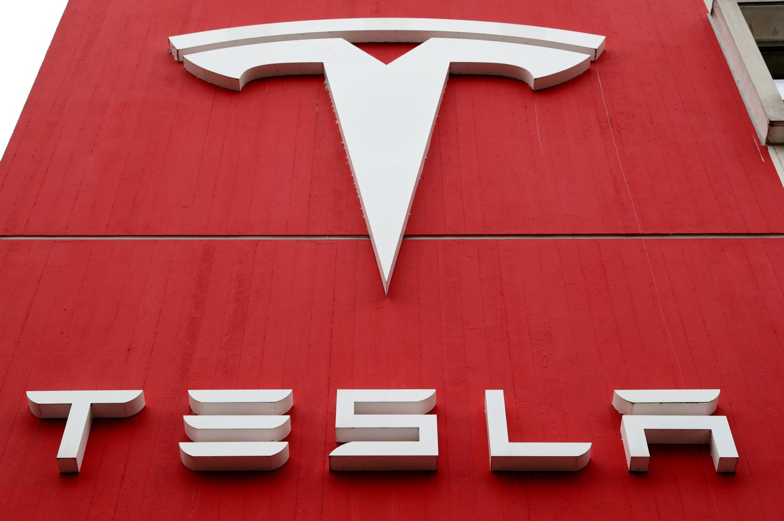 The logo of car manufacturer Tesla is seen at a branch office in Bern, Switzerland, Oct. 28, 2020. (Reuters Photo)