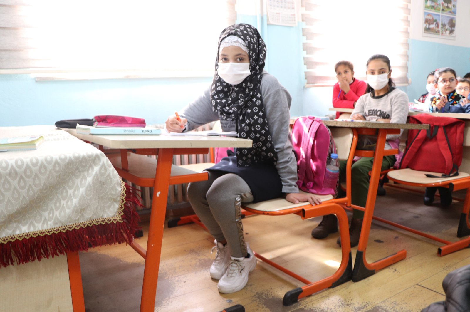 Seyma Elcellud poses in school after having a prosthetic leg operation in Turkey, March 9, 2021. (AA Photo)