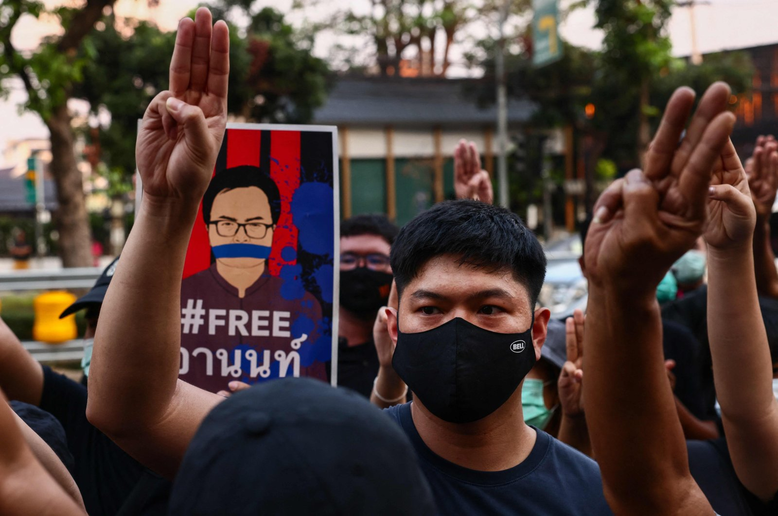 Pro-democracy protesters raise the three-finger salute outside the Criminal Court, during a demonstration against the detention of anti-government activists, Bangkok, Thailand, March 9, 2021. (AFP Photo)