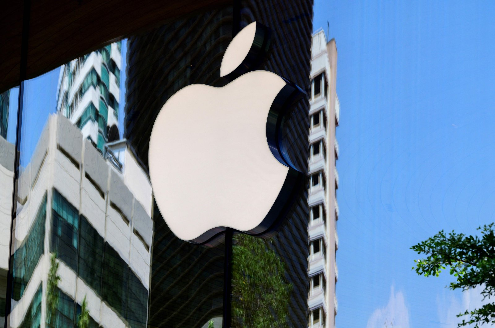 The Apple logo is seen on a window of the company's store in Bangkok on March 5, 2021. (AFP Photo)