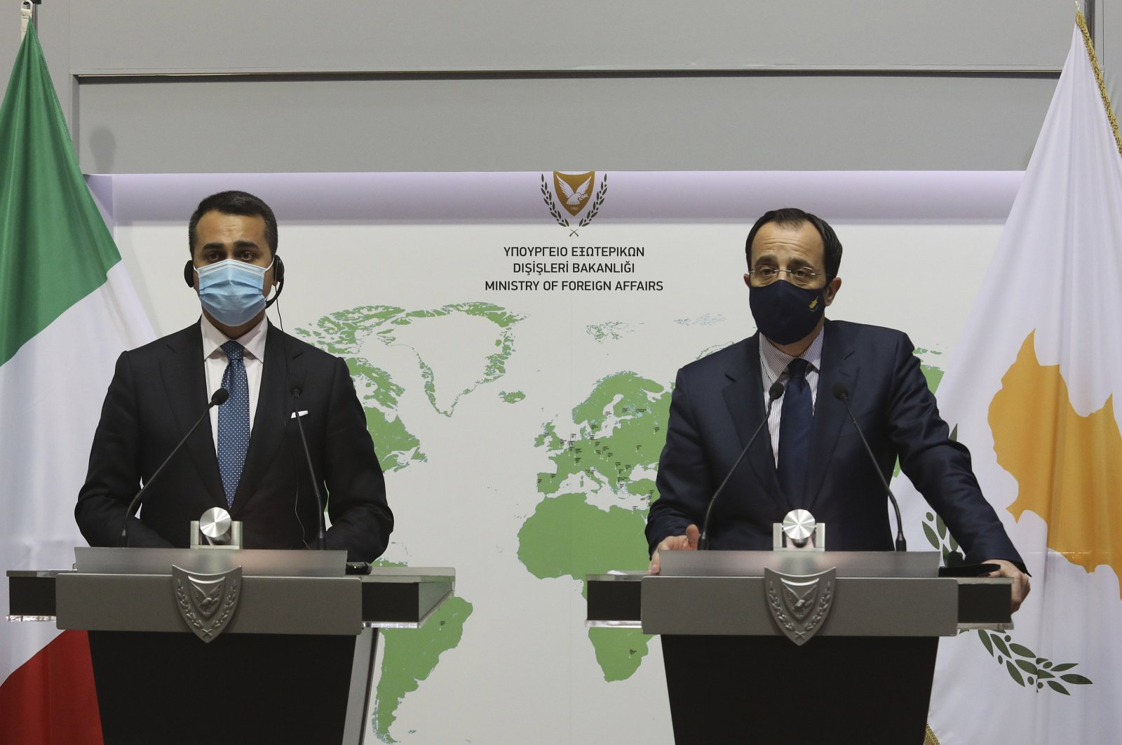 Greek Cypriot Foreign Minister Nicos Christodoulides, right, and Italian Foreign Minister Luigi Di Maio talk to the media during a news conference after their meeting in Nicosia, Greek Cyprus, Tuesday, March 9, 2021. (AP Photo)