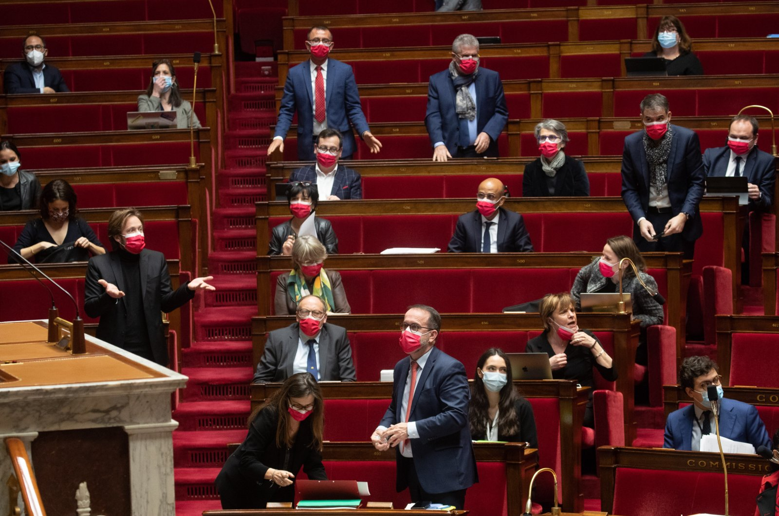 French Socialist Party lawmakers listen during a debate on a bill opening up the RSA (Social Solidarity Wage) to young people under 25 at the National Assembly in Paris, France, Feb. 18, Feb. 2021. (EPA Photo)