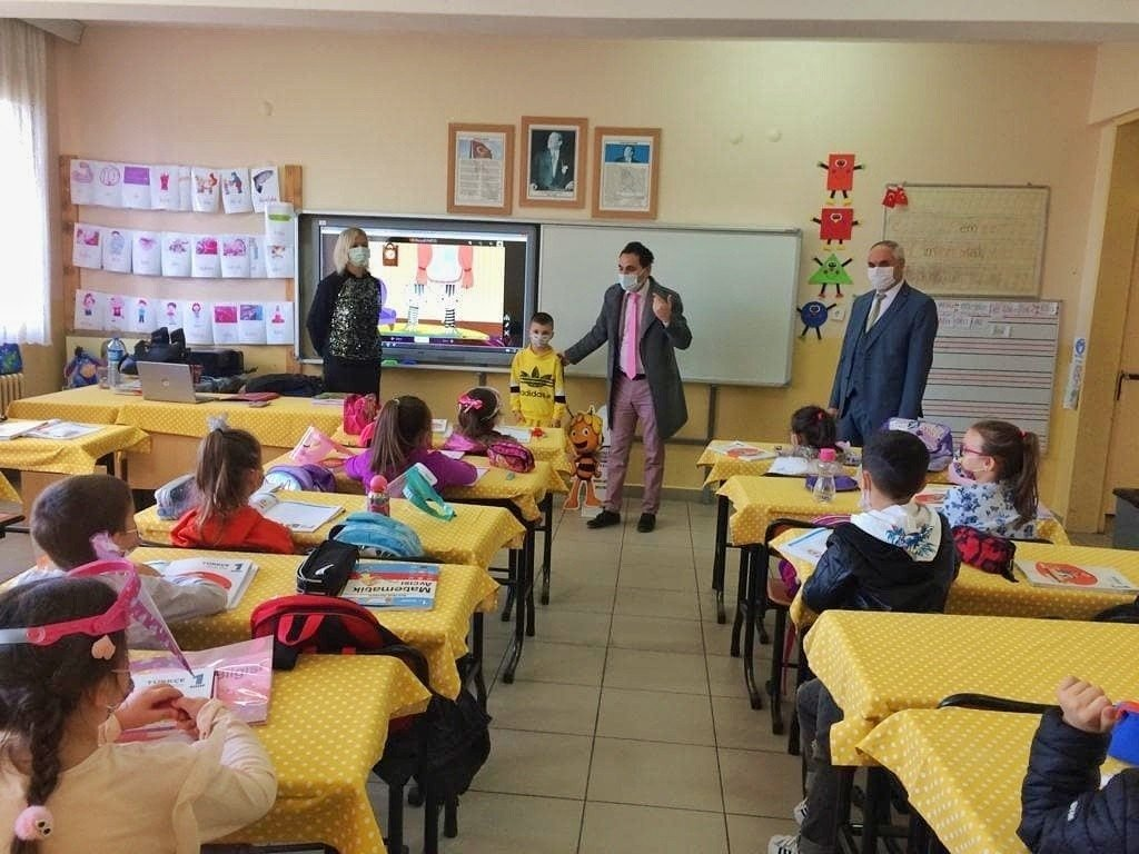 Students continue in-person education by observing coronavirus measures in a school in northwestern Edirne province, March 3, 2021. (IHA Photo)