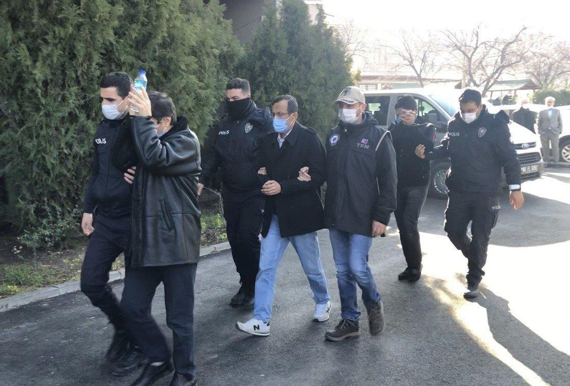 Police officers escort FETÖ suspects detained in the capital Ankara, Feb. 3, 2021. (IHA Photo)