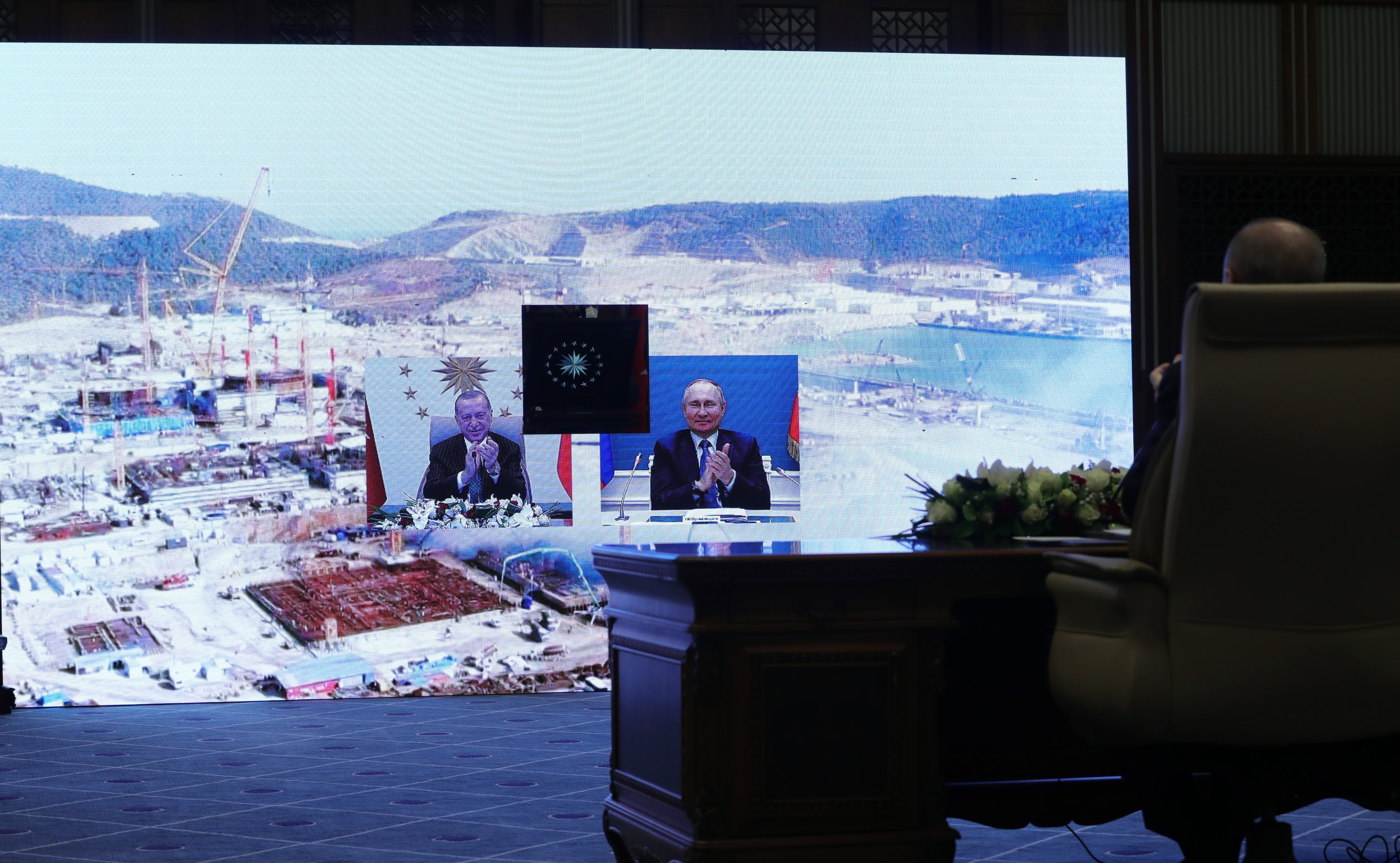 President Recep Tayyip Erdoğan sits on the far right, and on-screen bottom left, with Russia's President Vladimir Putin, bottom right, during a groundbreaking ceremony for the third reactor at the Akkuyu Nuclear Power Plant in Mersin province on the Mediterranean coast, in the capital Ankara, Turkey, March 10, 2021. (AA Photo)