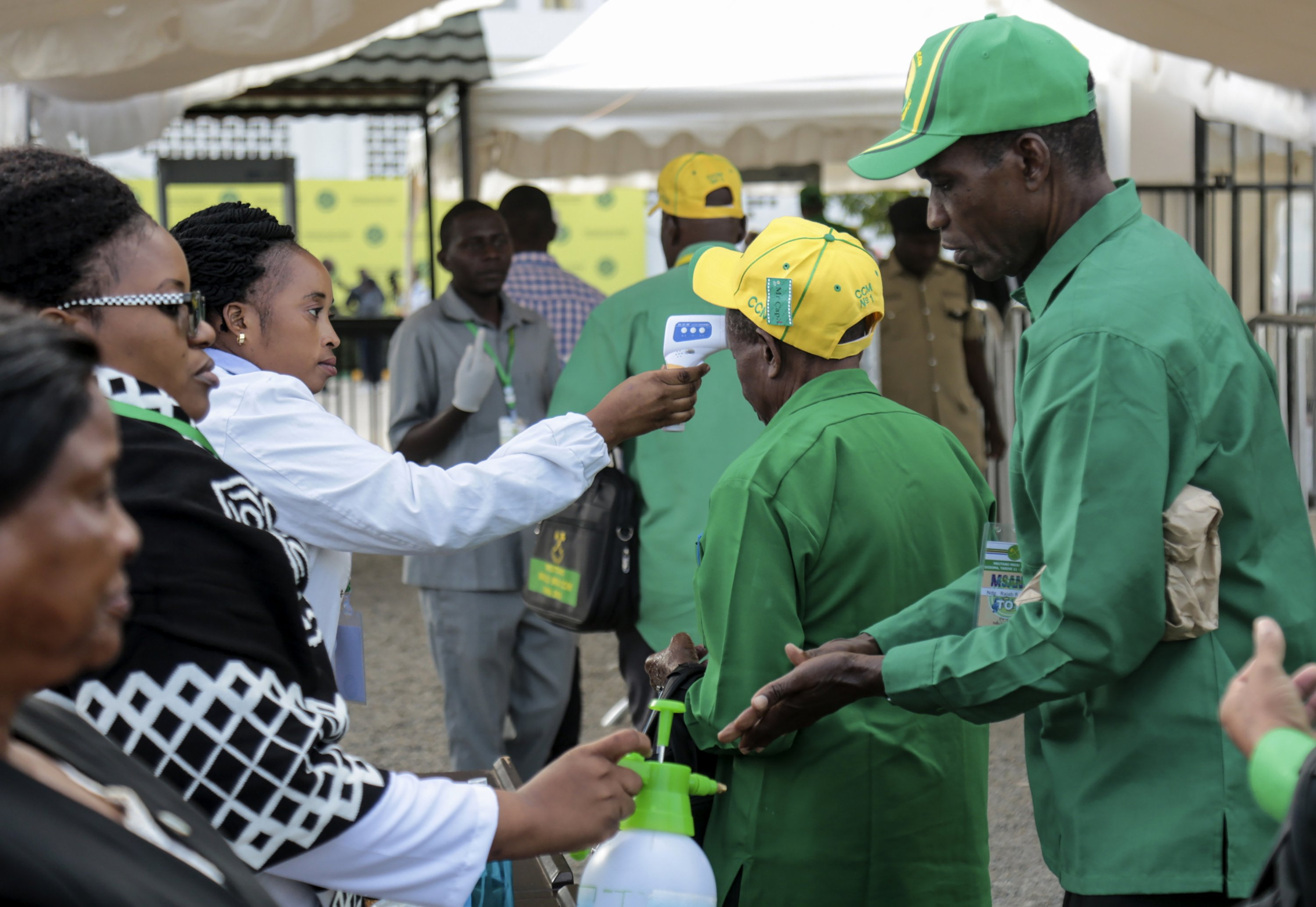 Party members have their temperature checked and sanitize their hands as a precaution against COVID-19 at the national congress of the ruling Chama cha Mapinduzi (CCM) party in Dodoma, Tanzania, July 11, 2020. (AP Photo)