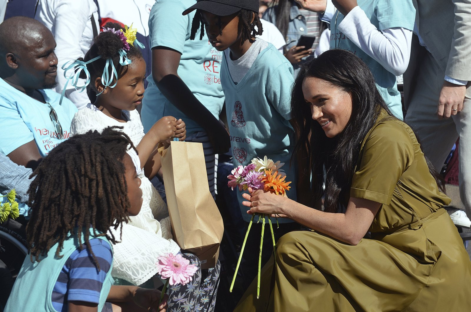 Meghan, the Duchess of Sussex, talks to children during a walkabout in Bo-Kaap, a heritage site, in Cape Town, South Africa, Sept, 24, 2019. (AP Photo)