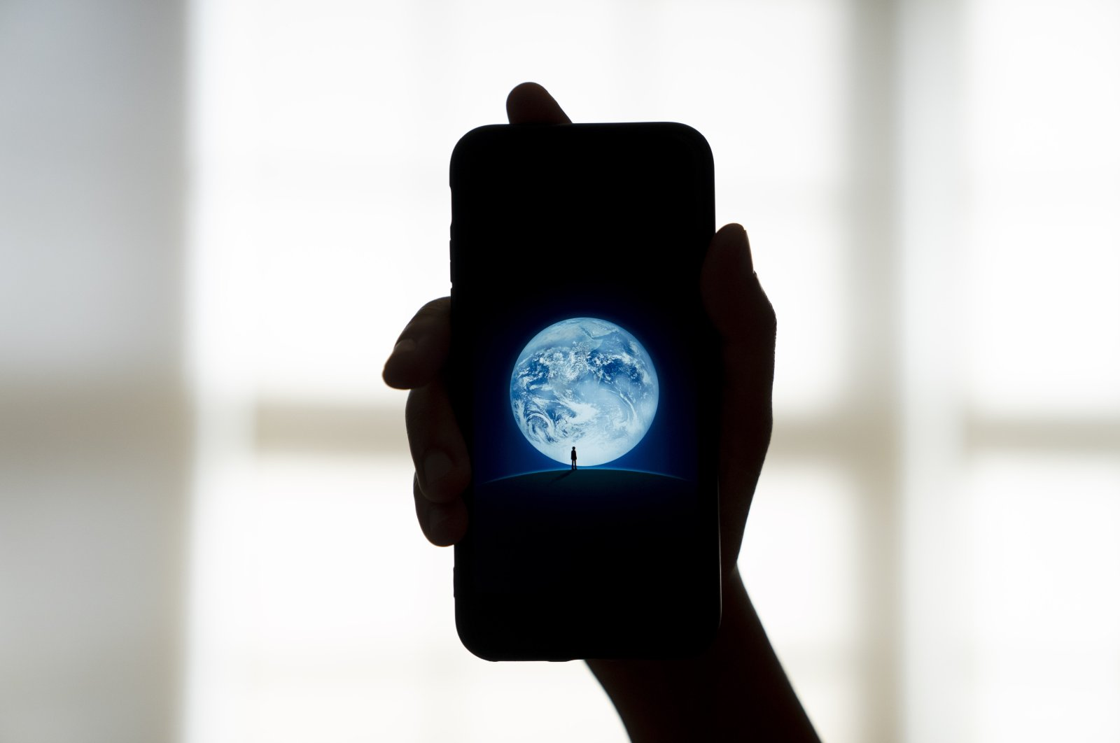 The Tencent Holdings Ltd. WeChat app is displayed on a smartphone in an arranged photograph taken in Arlington, Virginia, U.S., Aug. 7, 2020. (Photo by Getty Images)