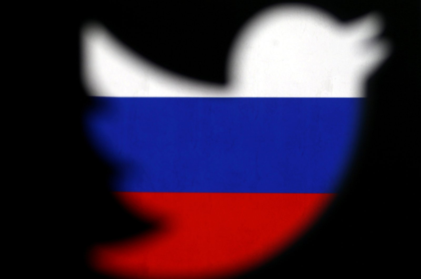 A 3D-printed Twitter logo displayed in front of the Russian flag is seen in this illustration picture, Oct. 27, 2017. (Reuters Photo)