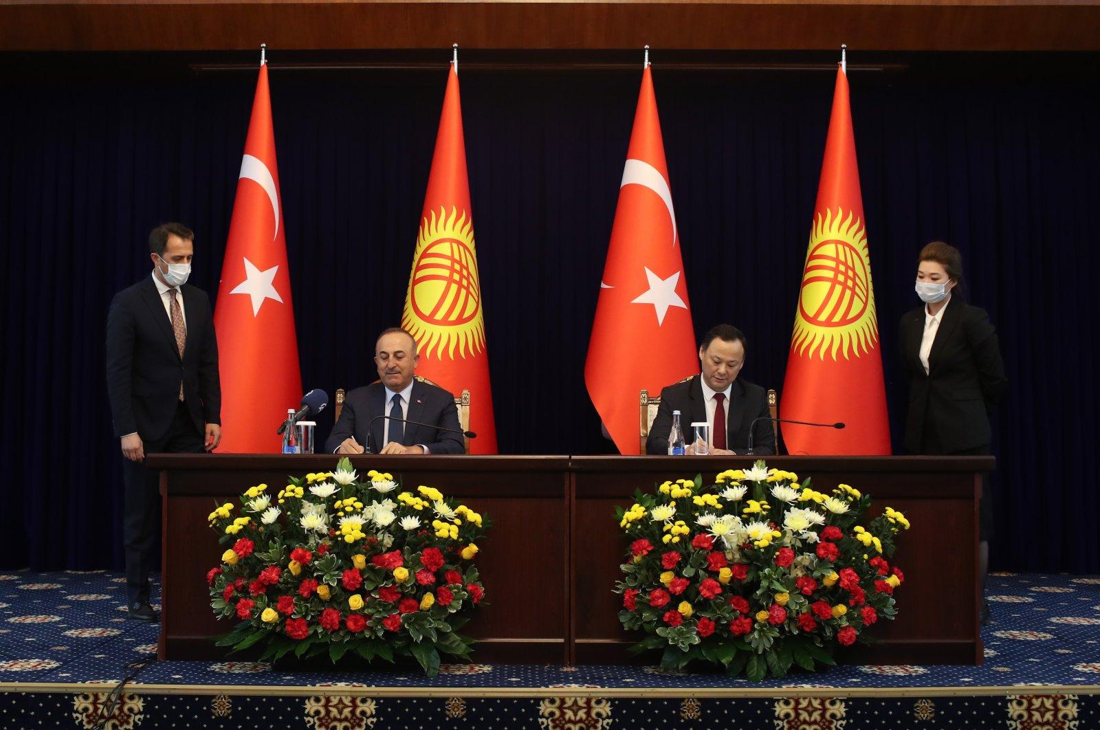 Foreign Minister Mevlüt Çavuşoğlu (L) and his Kyrgyz counterpart Ruslan Kazakbaev during a press conference in Bishkek, Kyrgyzstan, March 10, 2021. (AA Photo)