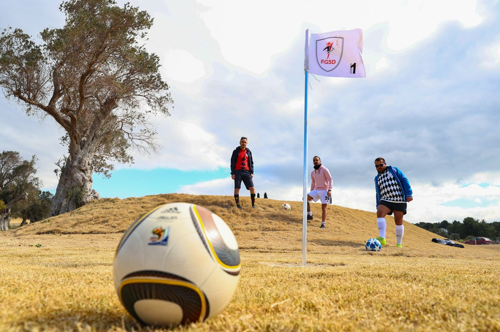 Footgolf players stand near a footgolf hole in Urla district, Izmir province, western Turkey, March 10, 2021. (AA Photo)