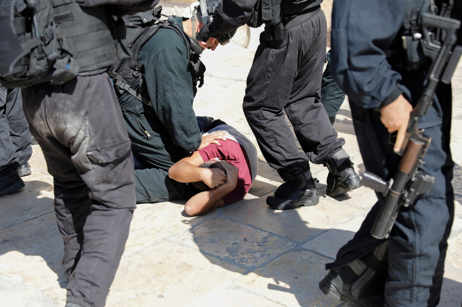 Israeli security forces detain a Palestinian at the Al-Aqsa Mosque compound in the Old City of Jerusalem, Israel, Aug. 11, 2019. (AFP Photo)