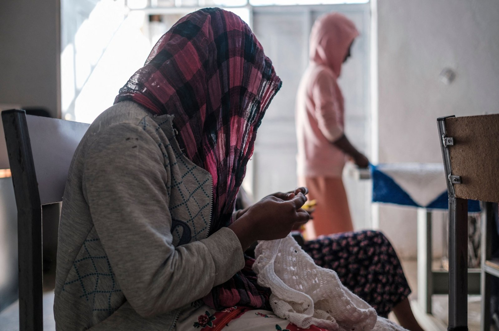 Survivors of sexual assault do handcrafts at a safe house in Mekele on Feb. 27, 2021. (AFP Photo)