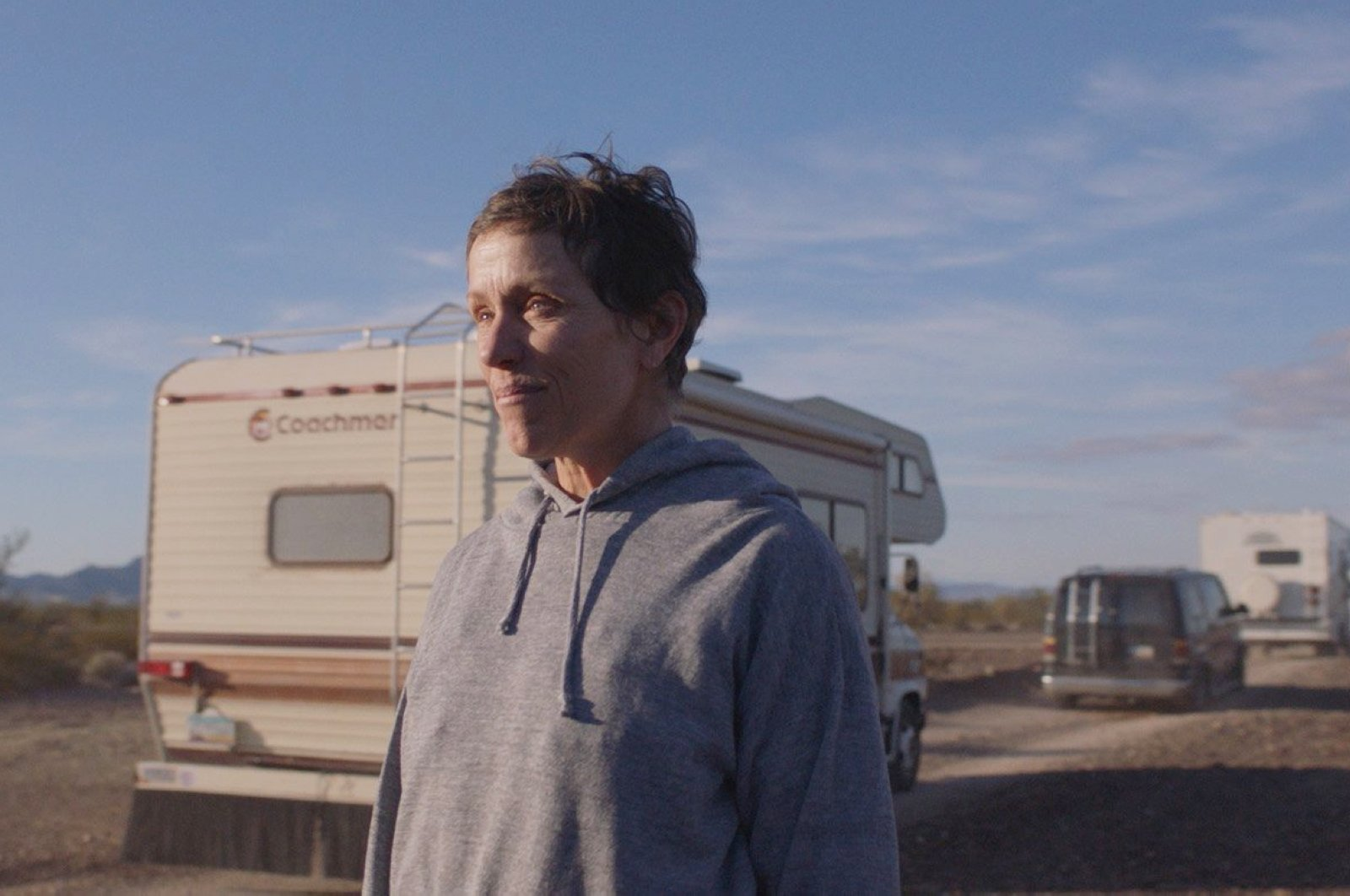 """This image released by Searchlight Pictures shows Frances McDormand in a scene from the film """"Nomadland."""" (AP Photo)"""