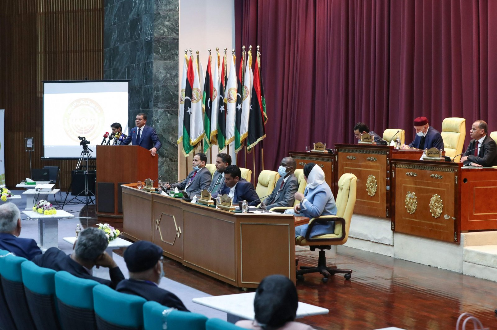 Libya's Prime Minister-designate Abdul Hamid Dbeibah addresses lawmakers during the first reunited parliamentarian session, in the coastal city of Sirte east of the capital, on March 9, 2021. (AFP Photo)
