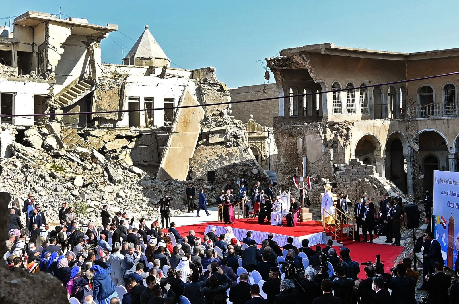 Pope Francis speaks at a square near the ruins of the Syriac Catholic Church of the Immaculate Conception (al-Tahira-l-Kubra), in the old city of Iraq's northern Mosul, March 7, 2021. (AFP Photo)
