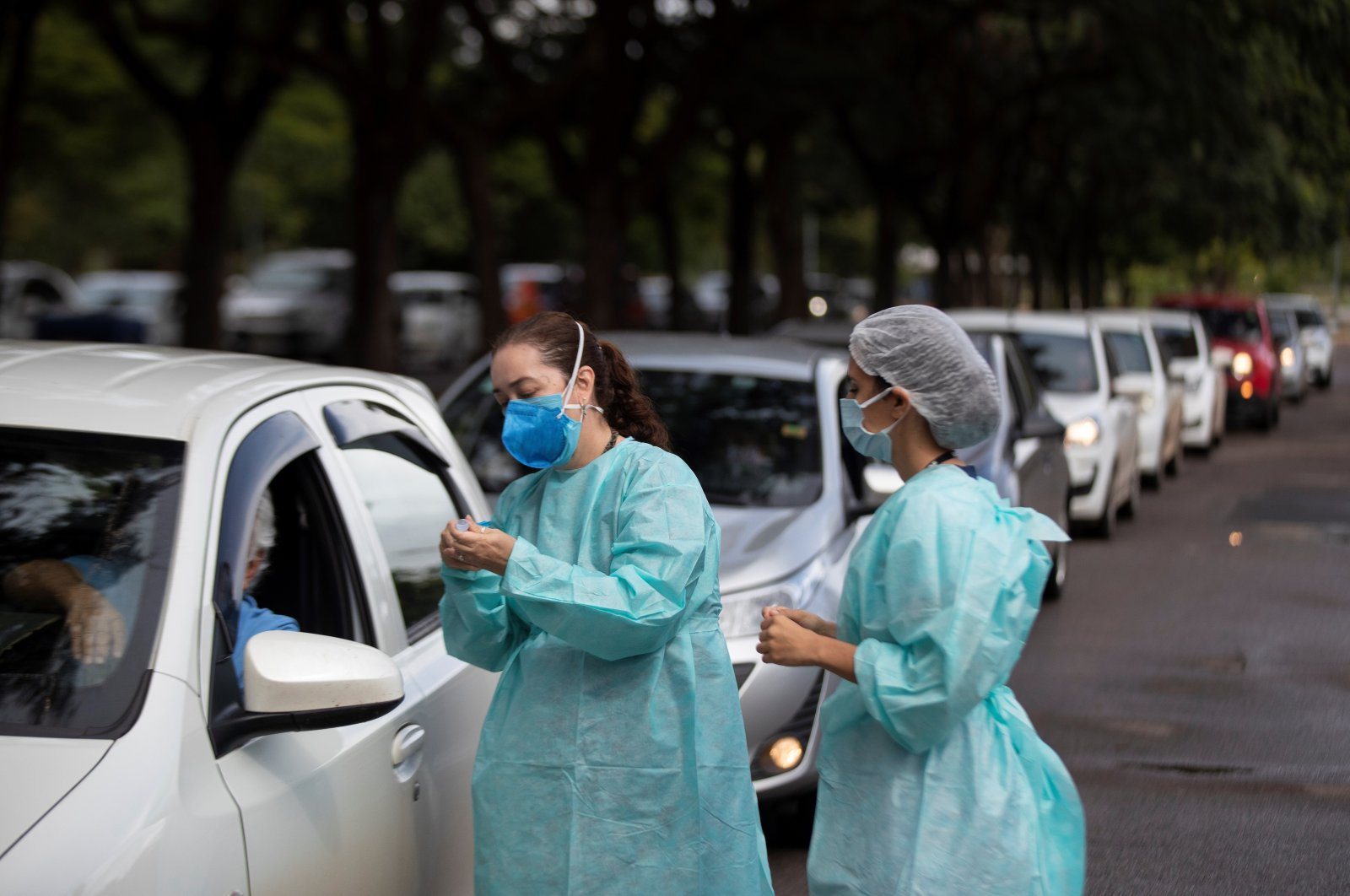 A health worker prepares a dose of the COVID-19 vaccine during a day of vaccination at a drive-in in Brasilia, Brazil, Feb. 26, 2021. (EPA-EFE Photo)