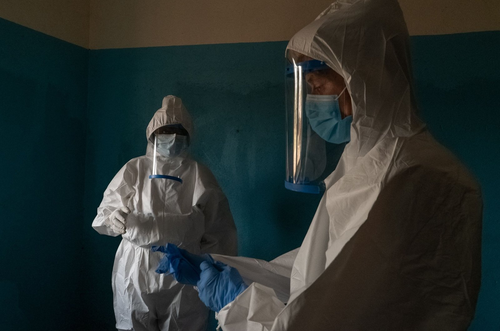 A multidisciplinary team mandated by the Provincial Health Division put on personal protective equipment (PPE) in Ituri, Democratic Republic of Congo on Feb. 26, 2021. (AFP Photo)