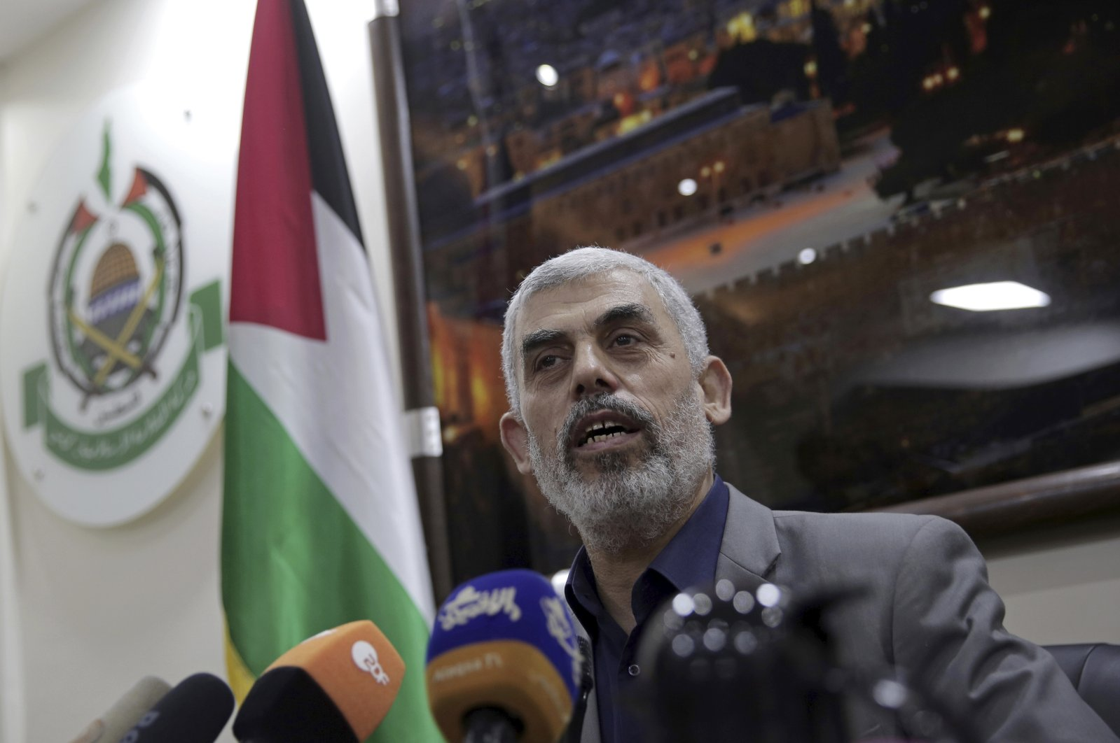 Yehiyeh Sinwar, the Hamas resistance group's leader in the Gaza Strip, speaks to foreign correspondents, in his office in Gaza City, May 10, 2018. (AP Photo)
