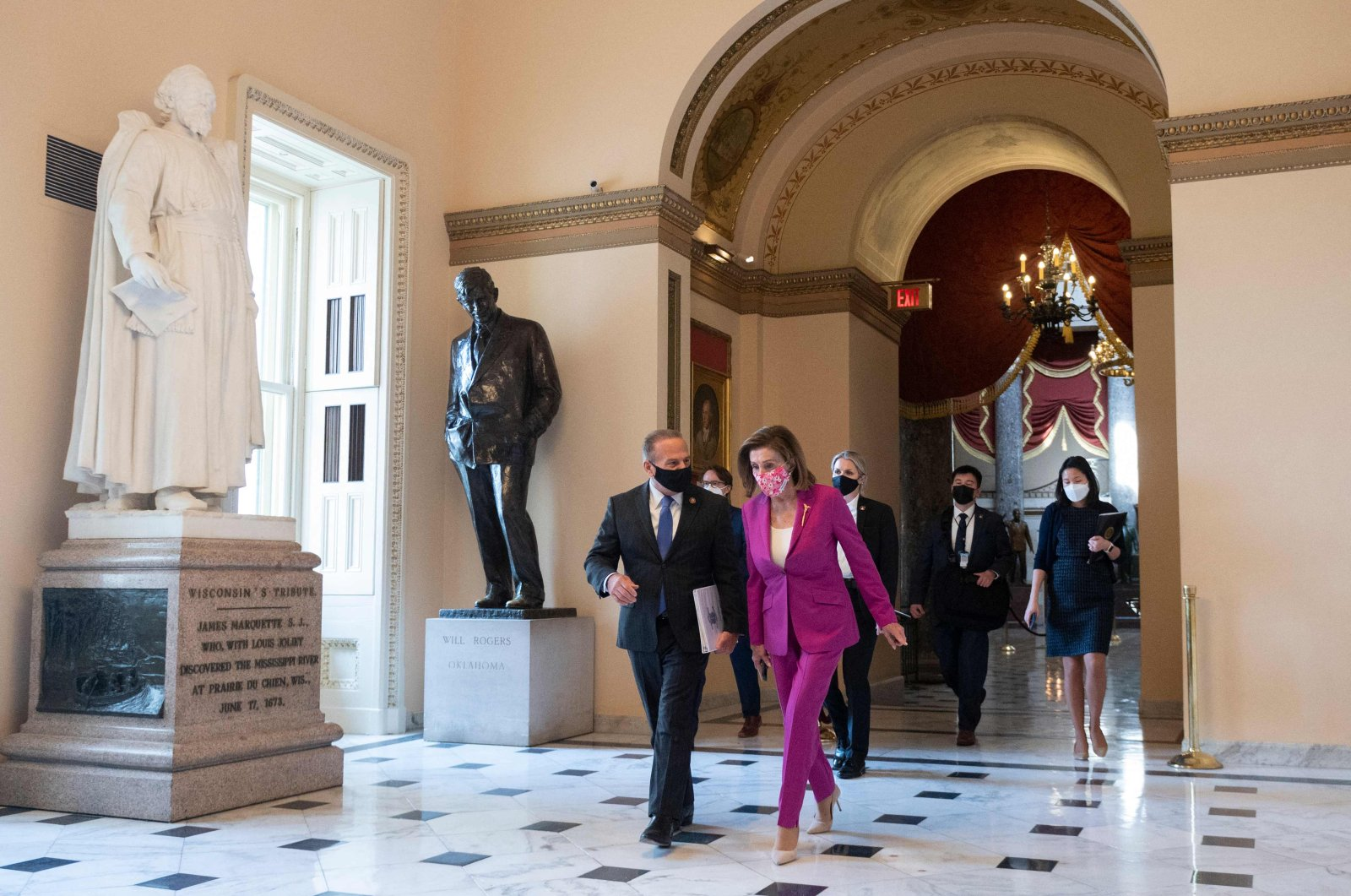 US Speaker of the House Nancy Pelosi (C) walks to the House side of the US Capitol in Washington, US, March 9, 2021. (AFP Photo)