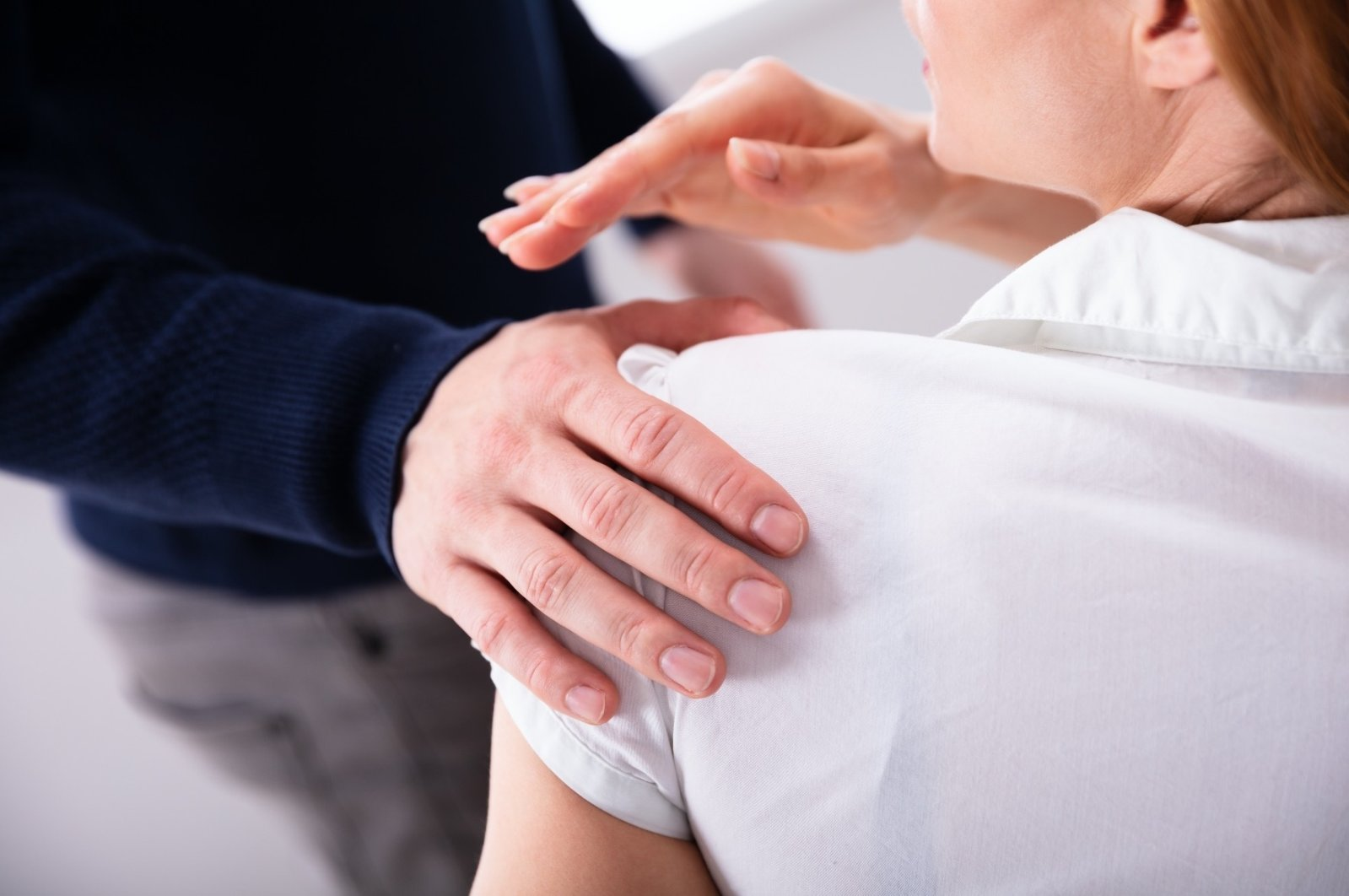 A manager sexually harasses a young female employee at the office. (Shutterstock Photo)