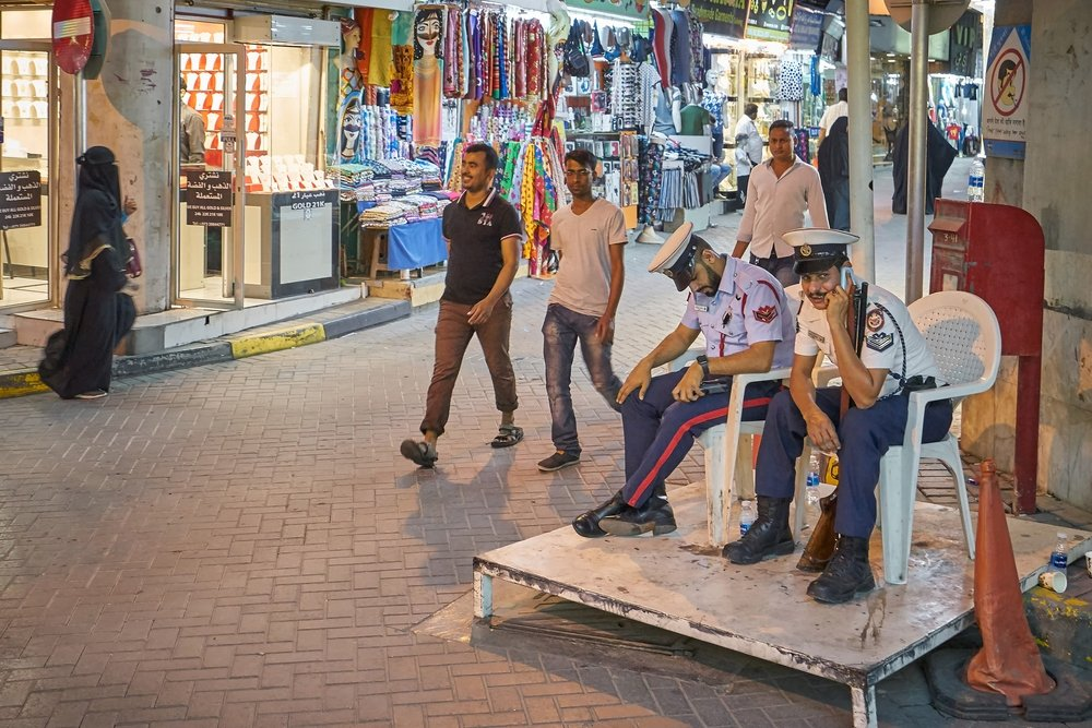 Policemen sitting at the shopping street in Manama during night, Bahrain, April 8, 2019. (Shutterstock Photo)