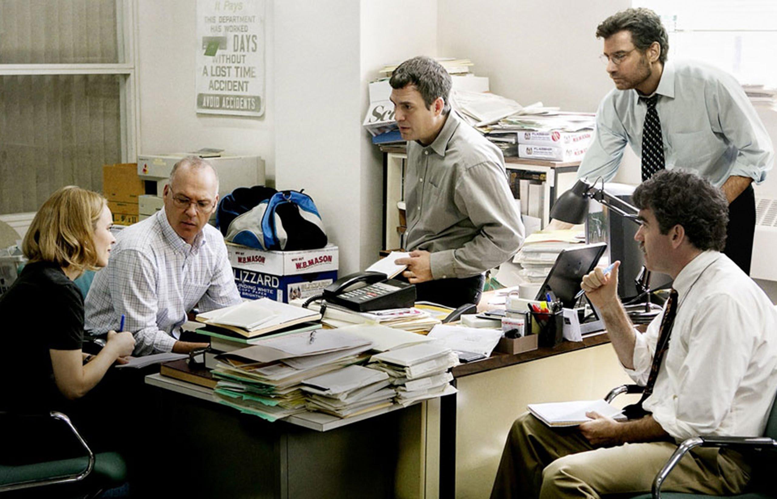 A still shot shows five Boston Globe newspaper journalists in a scene from 'Spotlight.'