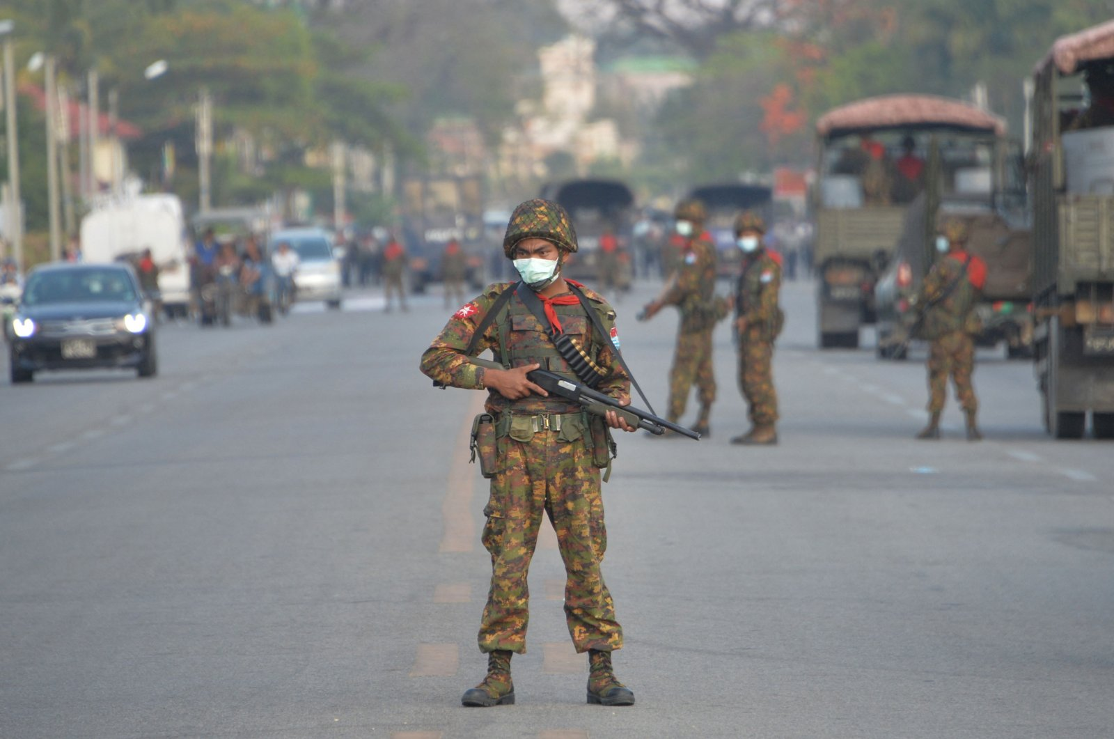A Myanmar soldier stands guard on a road amid demonstrations against the military coup in Naypyidaw on Feb. 17, 2021. (AFP Photo)